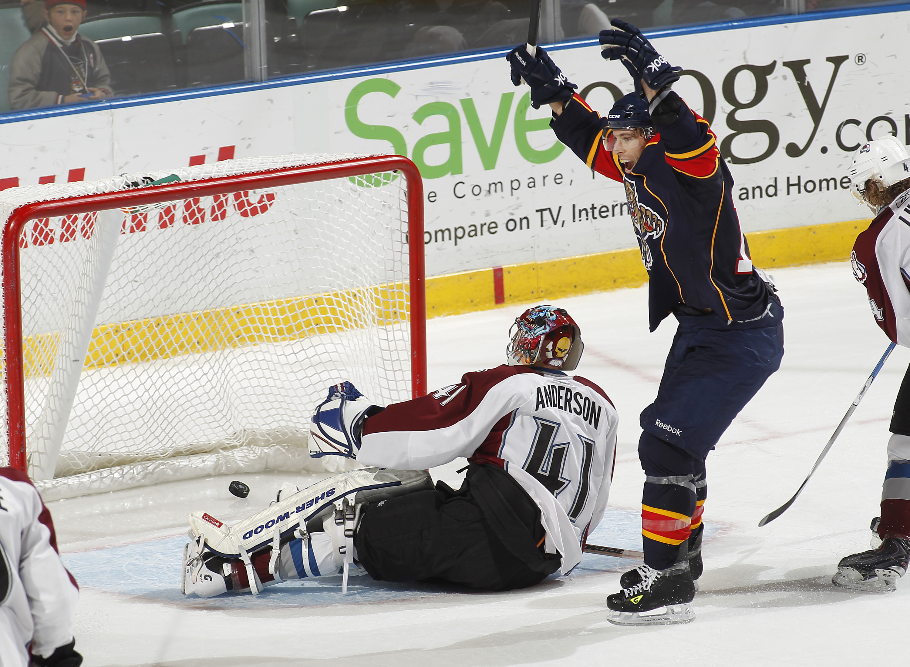SUNRISE, FL - DECEMBER 7: Goaltender Craig Anderson #41 of the Colorado Avalanche looks back at the net as David Booth #10 celebrates the overtime goal by Stephen Weiss #9 of the Florida Panthers in overtime on December 7, 2010 at the BankAtlantic Center