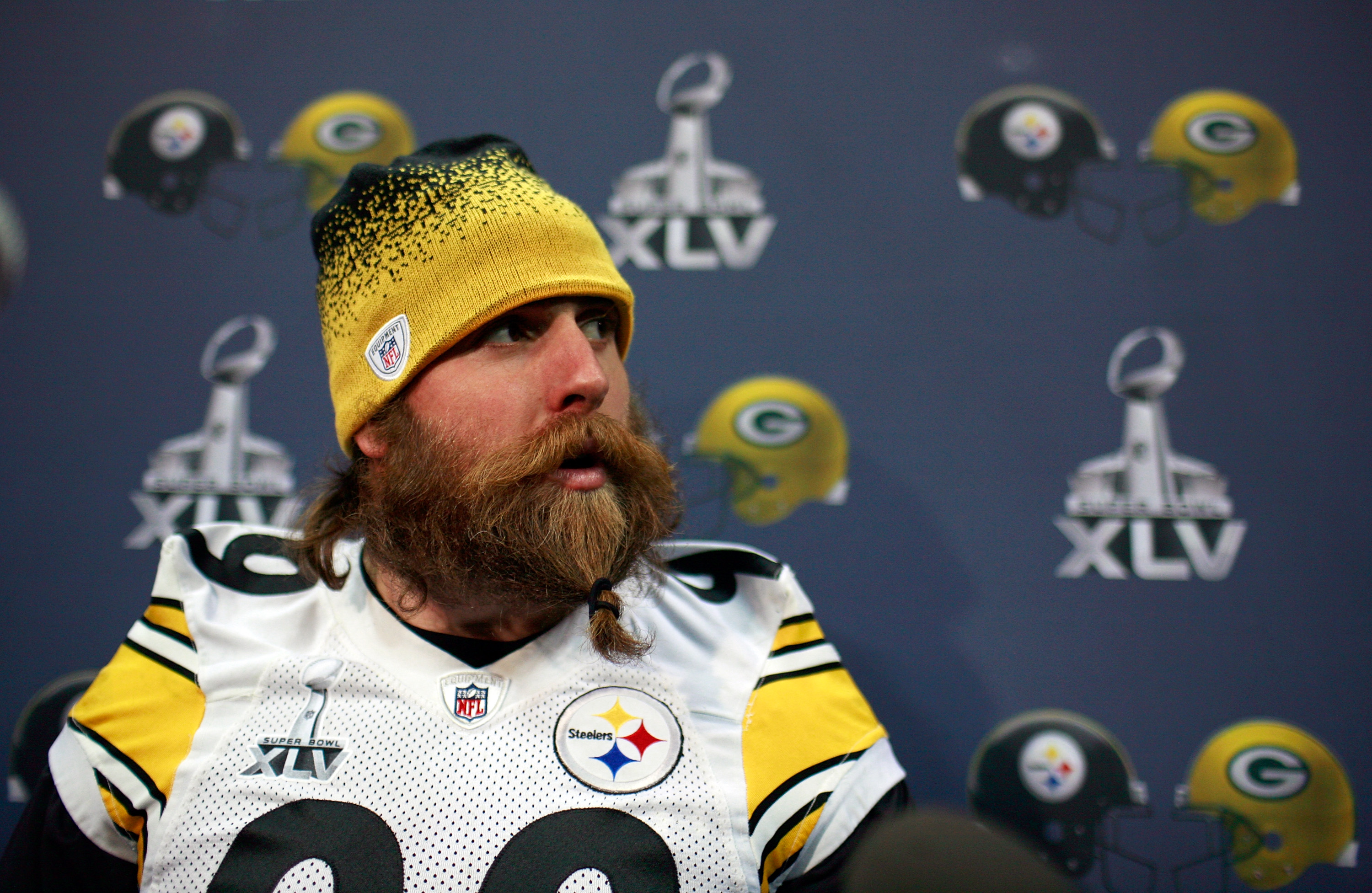 FORT WORTH, TX - FEBRUARY 02:  Defensive end Brett Keisel #99 of the Pittsburgh Steelers gathers his beard in an elastic hairband while talking with the media on February 2, 2011 in Fort Worth, Texas. The Pittsburgh Steelers will play the Green Bay Packer