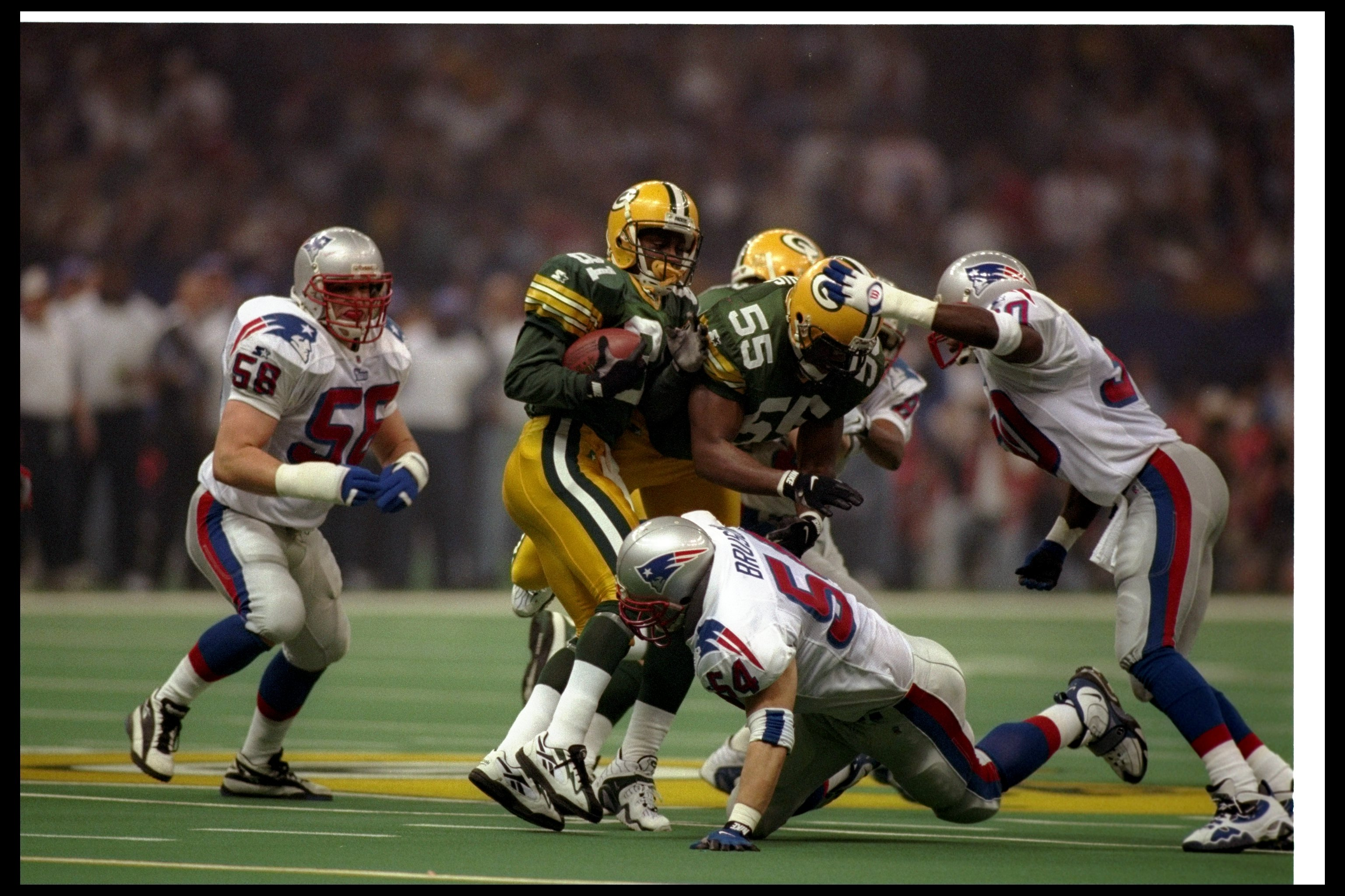 26 Jan 1997:  Wide receiver Desmond Howard of the Green Bay Packers gets tackled during Super Bowl XXXI against the New England Patriots at the Superdome in New Orleans, Louisiana.  The Packers won the game, 35-21. Mandatory Credit: Al Bello  /Allsport