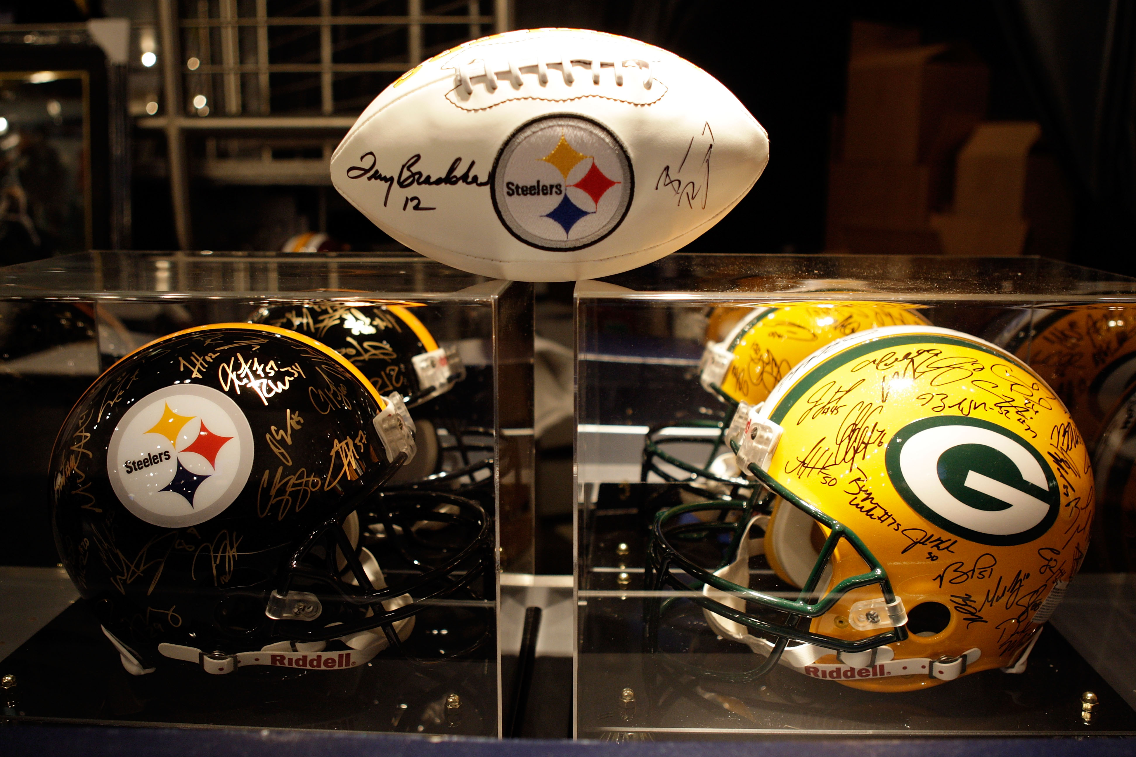 ARLINGTON, TX - FEBRUARY 06:  Signed Pittsburgh Steelers and Green Bay Packers helmets and footballs are displayed inside the Pro Shop at Cowboys Stadium before Super Bowl XLV on February 6, 2011 in Arlington, Texas.  (Photo by Jamie Squire/Getty Images)