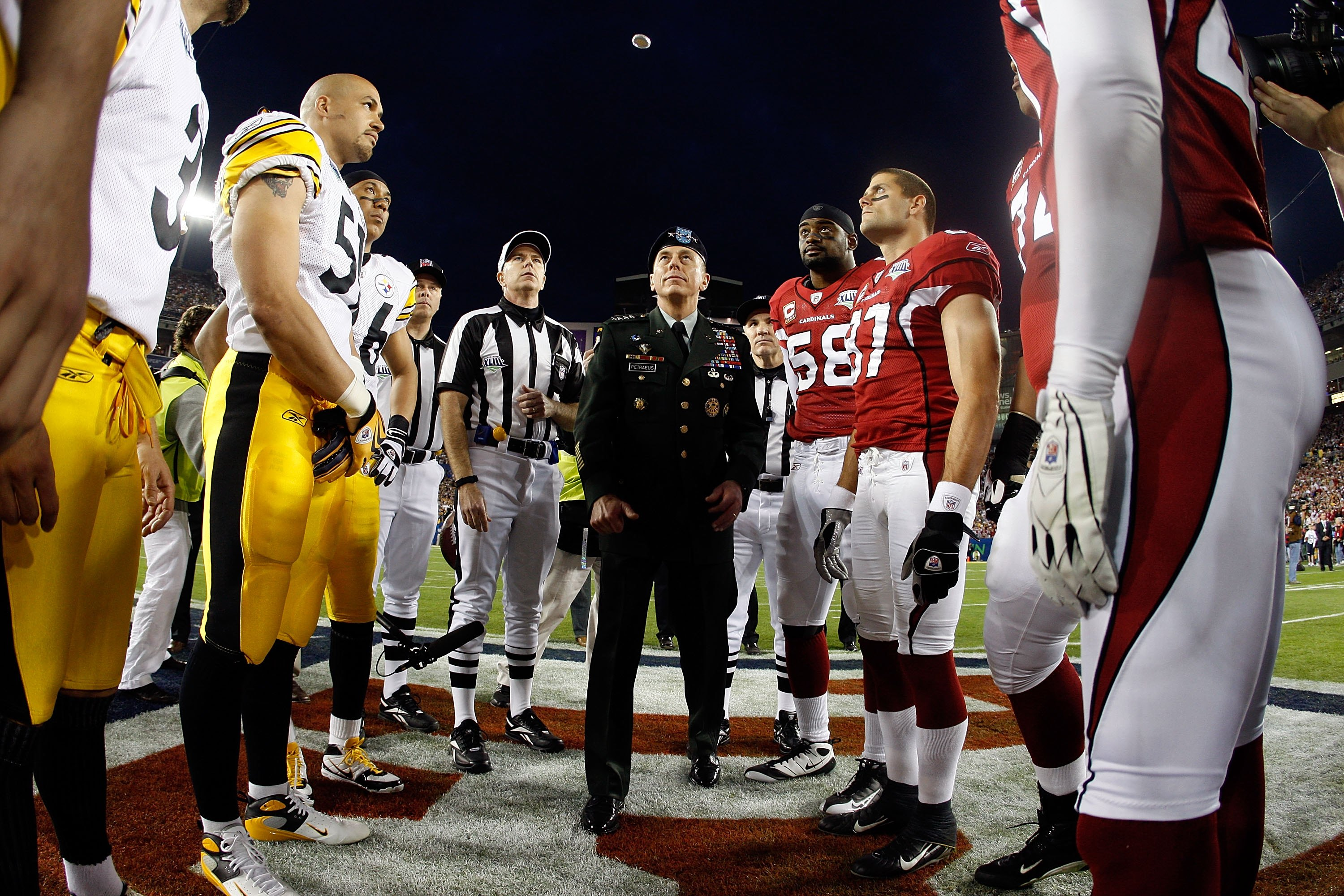TAMPA, FL - FEBRUARY 01:  General David H. Petraeus, commander of the United States Central Command, performs the coin toss before Super Bowl XLIII between the Arizona Cardinals and the Pittsburgh Steelers on February 1, 2009 at Raymond James Stadium in T