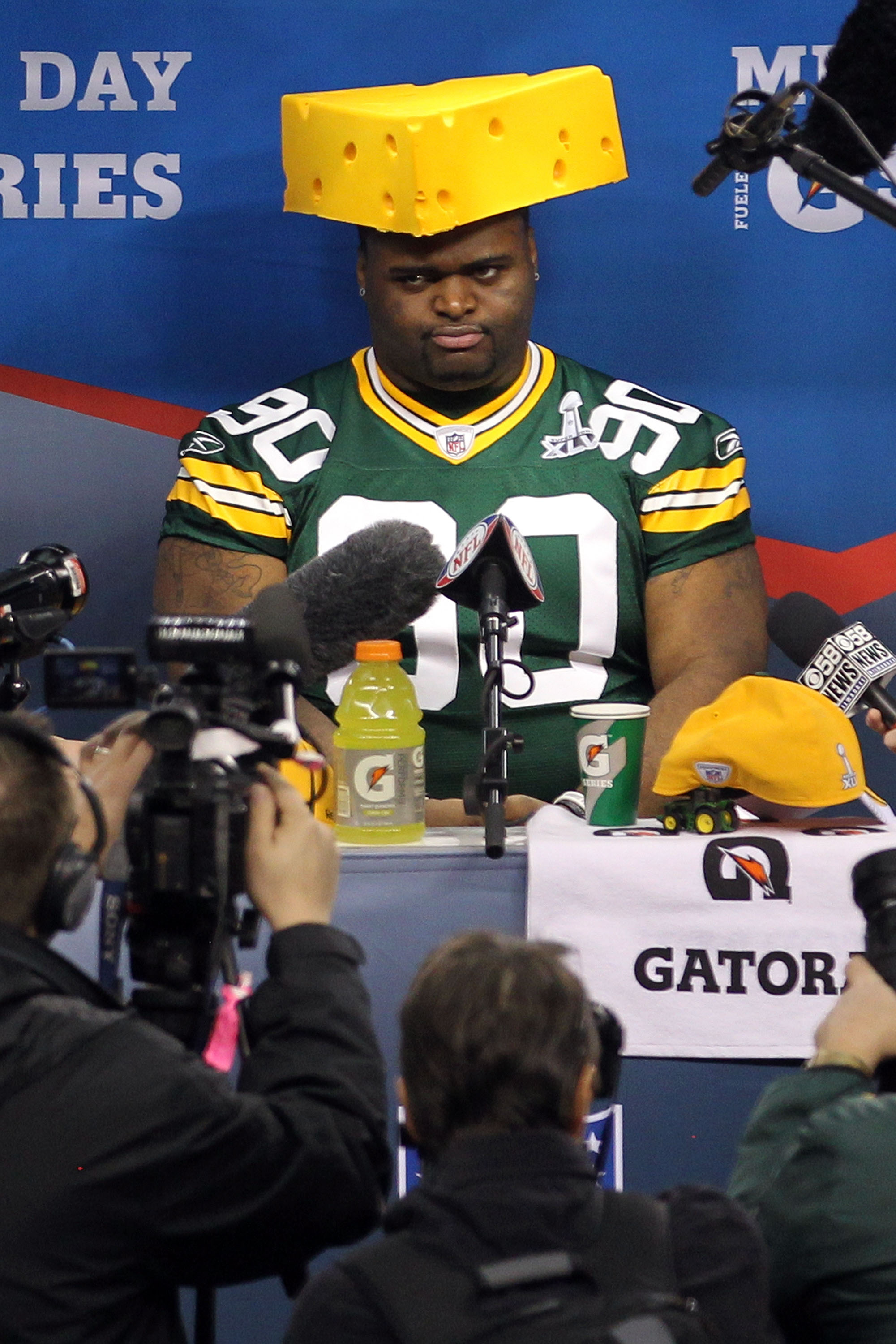 ARLINGTON, TX - FEBRUARY 01:  B.J. Raji #90 of the Green Bay Packers puts on a cheesehead during Super Bowl XLV Media Day ahead of Super Bowl XLV at Cowboys Stadium on February 1, 2011 in Arlington, Texas. The Pittsburgh Steelers will play the Green Bay P