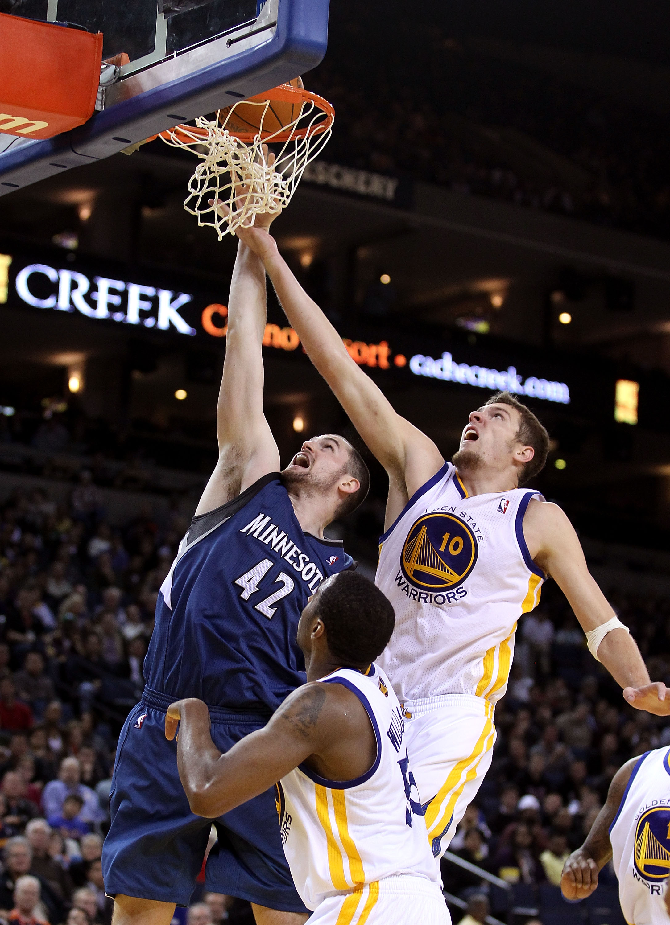 OAKLAND, CA - DECEMBER 14:  Kevin Love #42 of the Minnesota Timberwolves shoots over David Lee #10 of the Golden State Warriors at Oracle Arena on December 14, 2010 in Oakland, California.  NOTE TO USER: User expressly acknowledges and agrees that, by dow