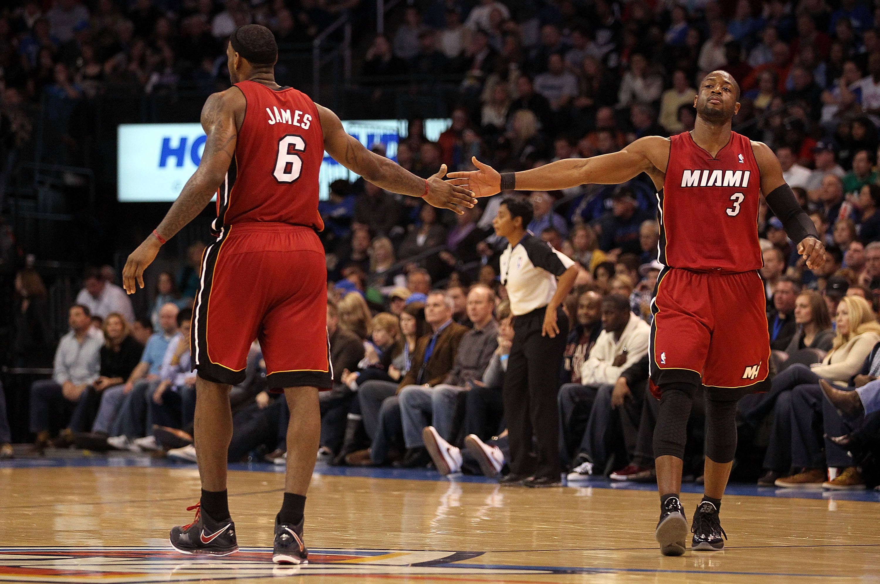 OKLAHOMA CITY, OK - JANUARY 30:  Forward LeBron James #6 and Dwyane Wade #3 of the Miami Heat slap hands during play against the Oklahoma City Thunder at Ford Center on January 30, 2011 in Oklahoma City, Oklahoma.  NOTE TO USER: User expressly acknowledge