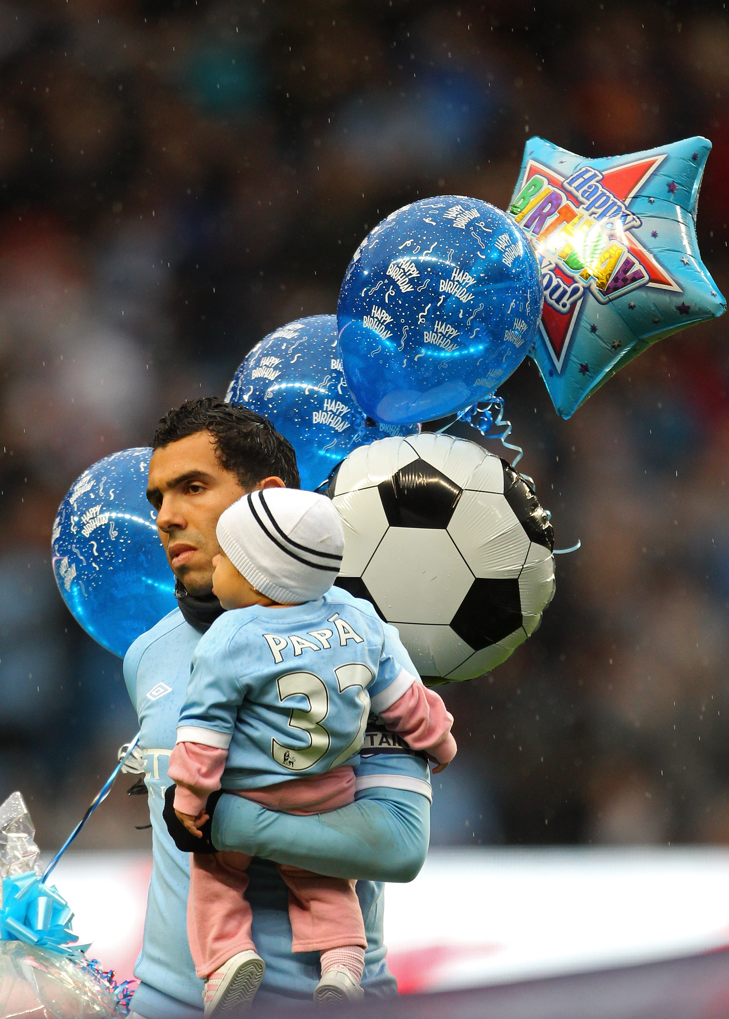 Tevez, right, in the arms of an anonymous footballer.