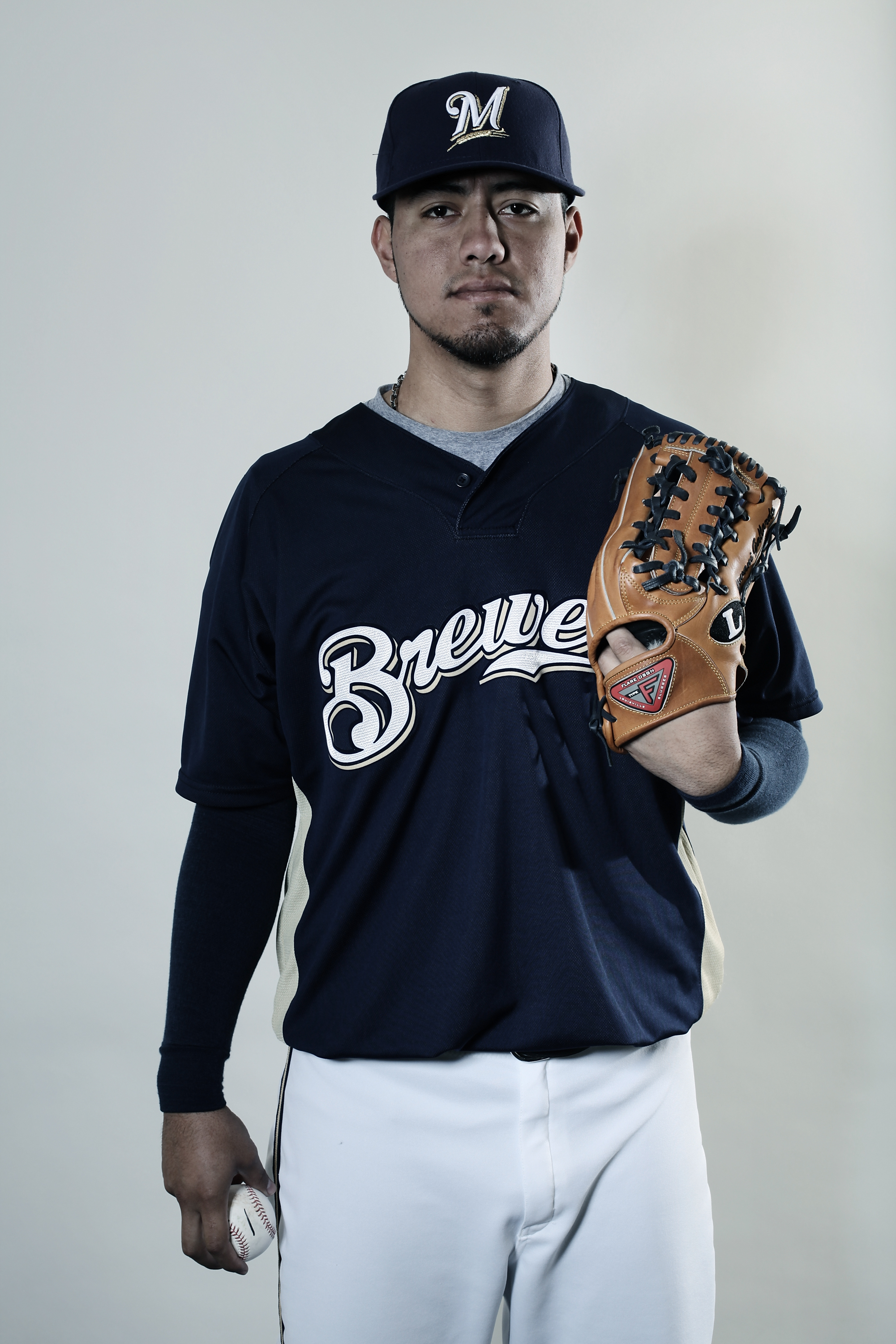 MARYVALE, AZ - MARCH 01:  (EDITORS NOTE: THIS IMAGES HAS BEEN DIGITALLY DESATURATED) Yovani Gallardo #49 poses for a portrait during the Milwaukee Brewers Photo Day at the Maryvale  Baseball Park on March 1, 2010 in Maryvale, Arizona.  (Photo by Jonathan