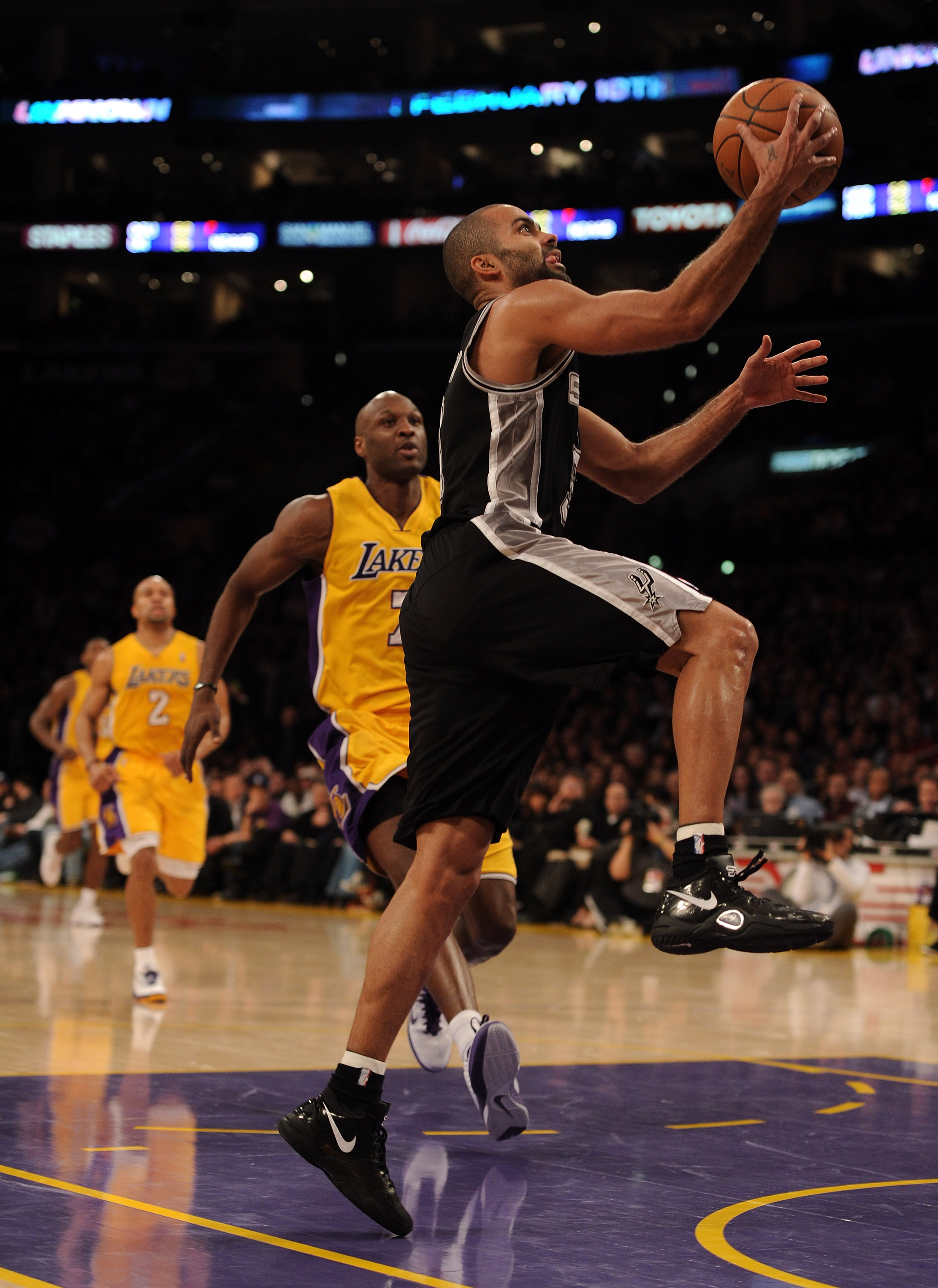 LOS ANGELES, CA - FEBRUARY 03:  Tony Parker #9 of the San Antonio Spurs scores a layup in front of Lamar Odom #7 of the Los Angeles Lakers at Staples Center on February 3, 2011 in Los Angeles, California.  NOTE TO USER: User expressly acknowledges and agr