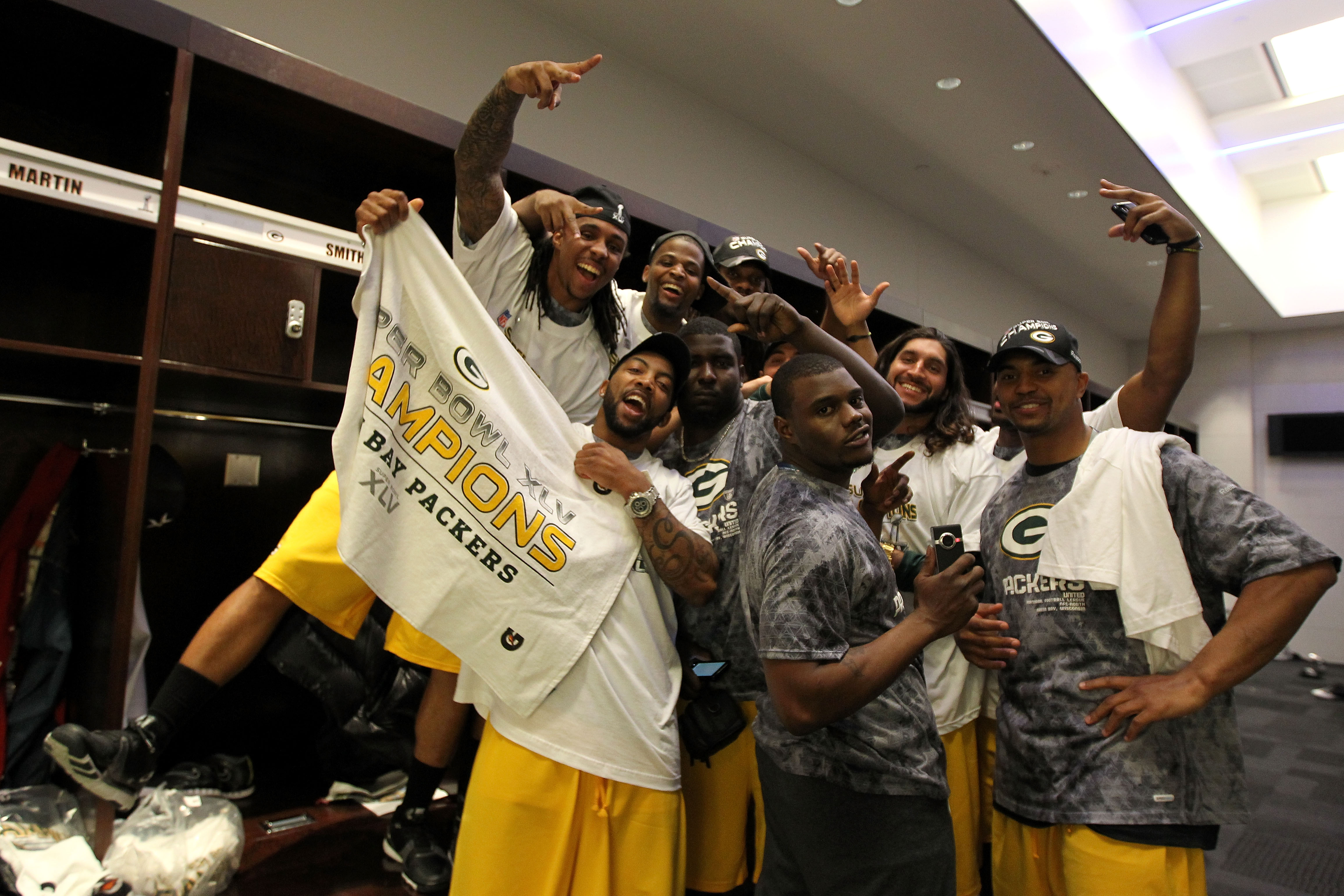 ARLINGTON, TX - FEBRUARY 06:  The Green Bay Packers celebrate in the locker room after winning Super Bowl XLV 31-25 against the Pittsburgh Steelers at Cowboys Stadium on February 6, 2011 in Arlington, Texas.  (Photo by Al Bello/Getty Images)