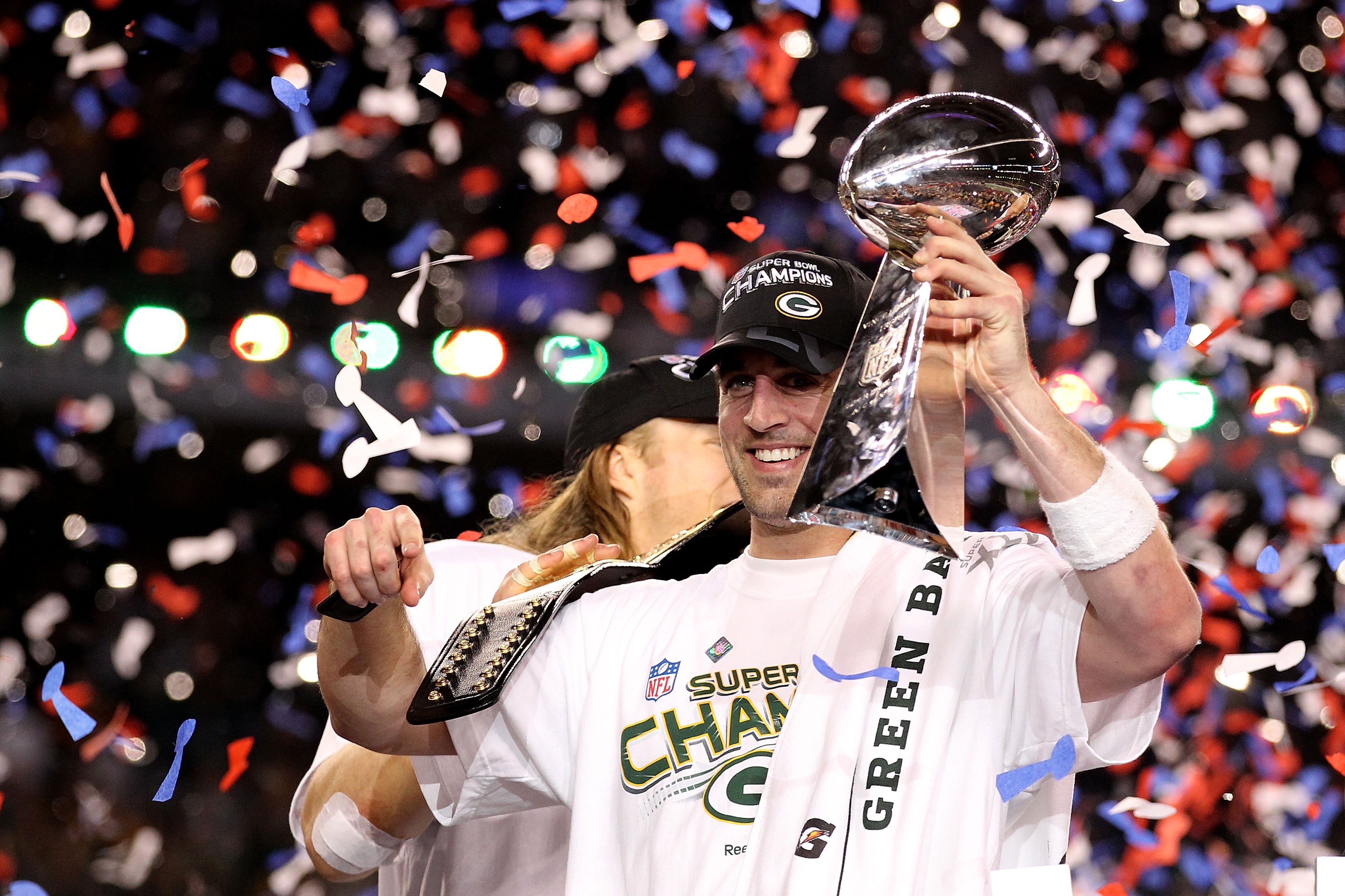 ARLINGTON, TX - FEBRUARY 06:  MVP Aaron Rodgers #12 of the Green Bay Packers celebrates with the Lombardi Trophy after winning Super Bowl XLV against the Pittsburgh Steelers at Cowboys Stadium on February 6, 2011 in Arlington, Texas.  (Photo by Al Bello/G