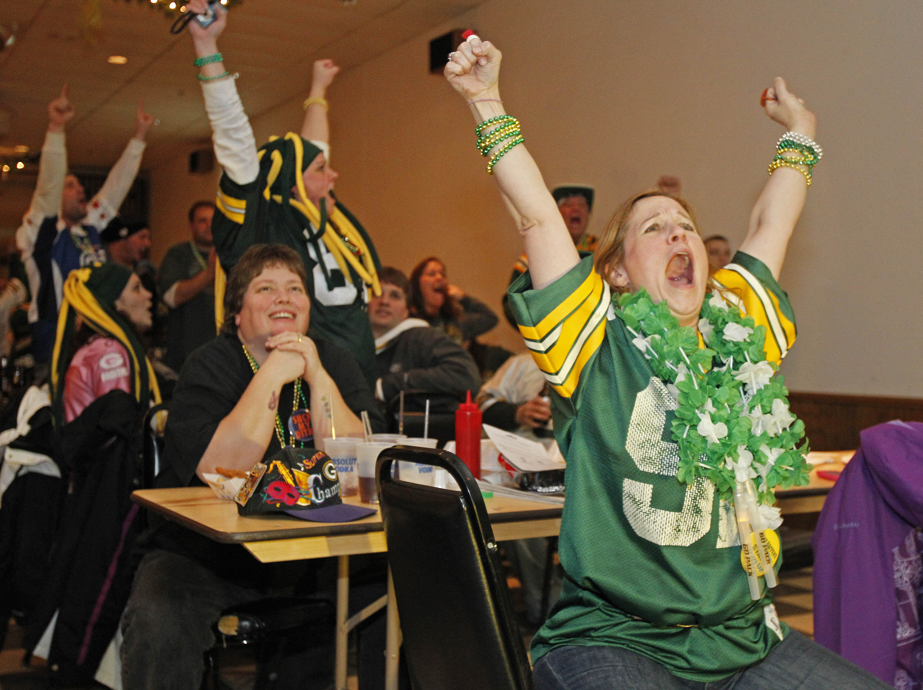 GREEN BAY, WI - FEBRUARY 06: Green Bay Packers fan Kitzi Muniz cheers after a play while watching the Super Bowl at Stadium View Bar on February 6, 2011 in Green Bay, Wisconsin.  (Photo by Matt Ludtke/Getty Images)