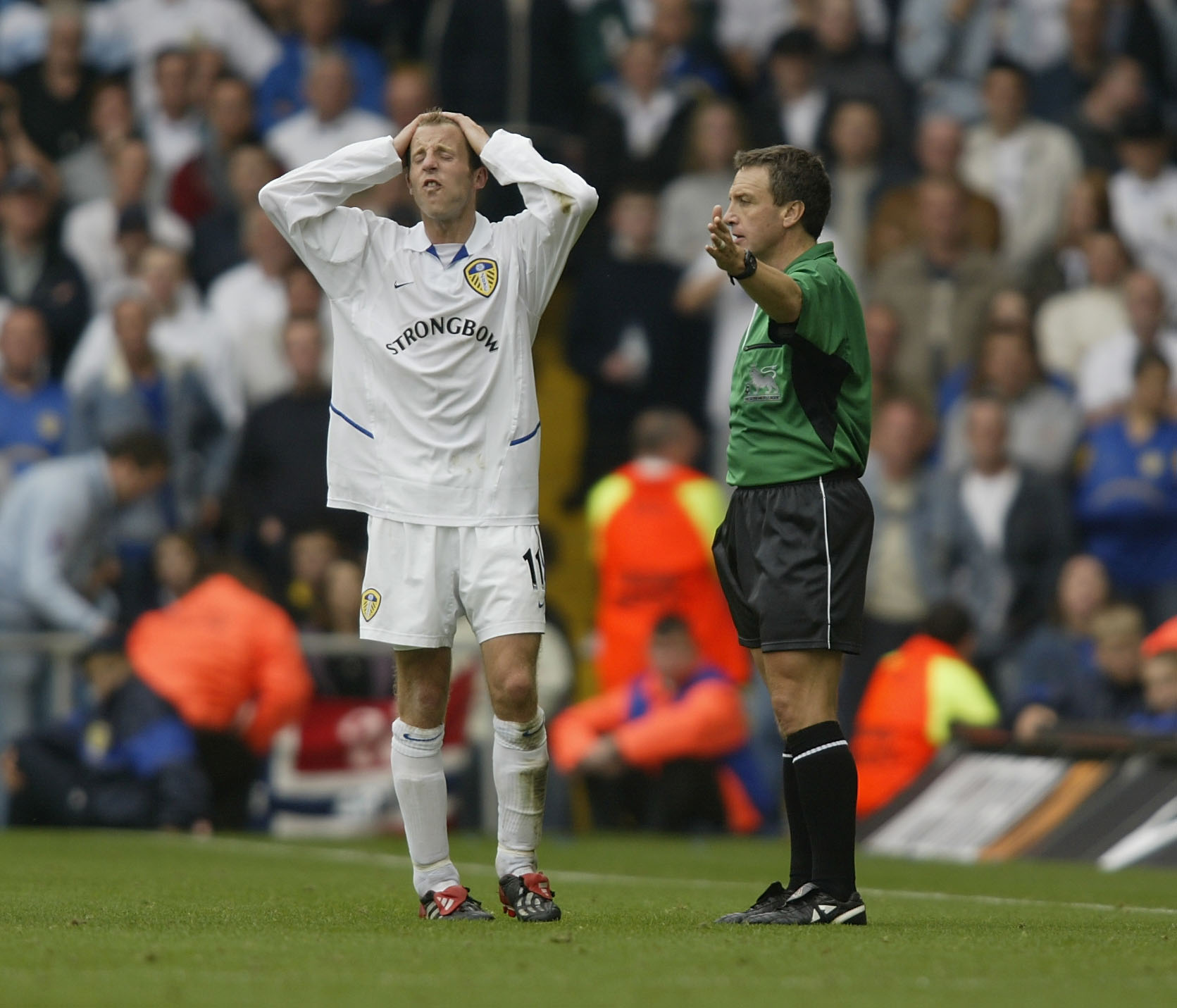 LEEDS - SEPTEMBER 28:  Lee Bowyer of Leeds United pleads with the assisstant referee after fouling Pascal Cynan of Arsenal during the FA Barclaycard Premiership match between Leeds United and Arsenal at Elland Road, Leeds, England on September 28, 2002. (