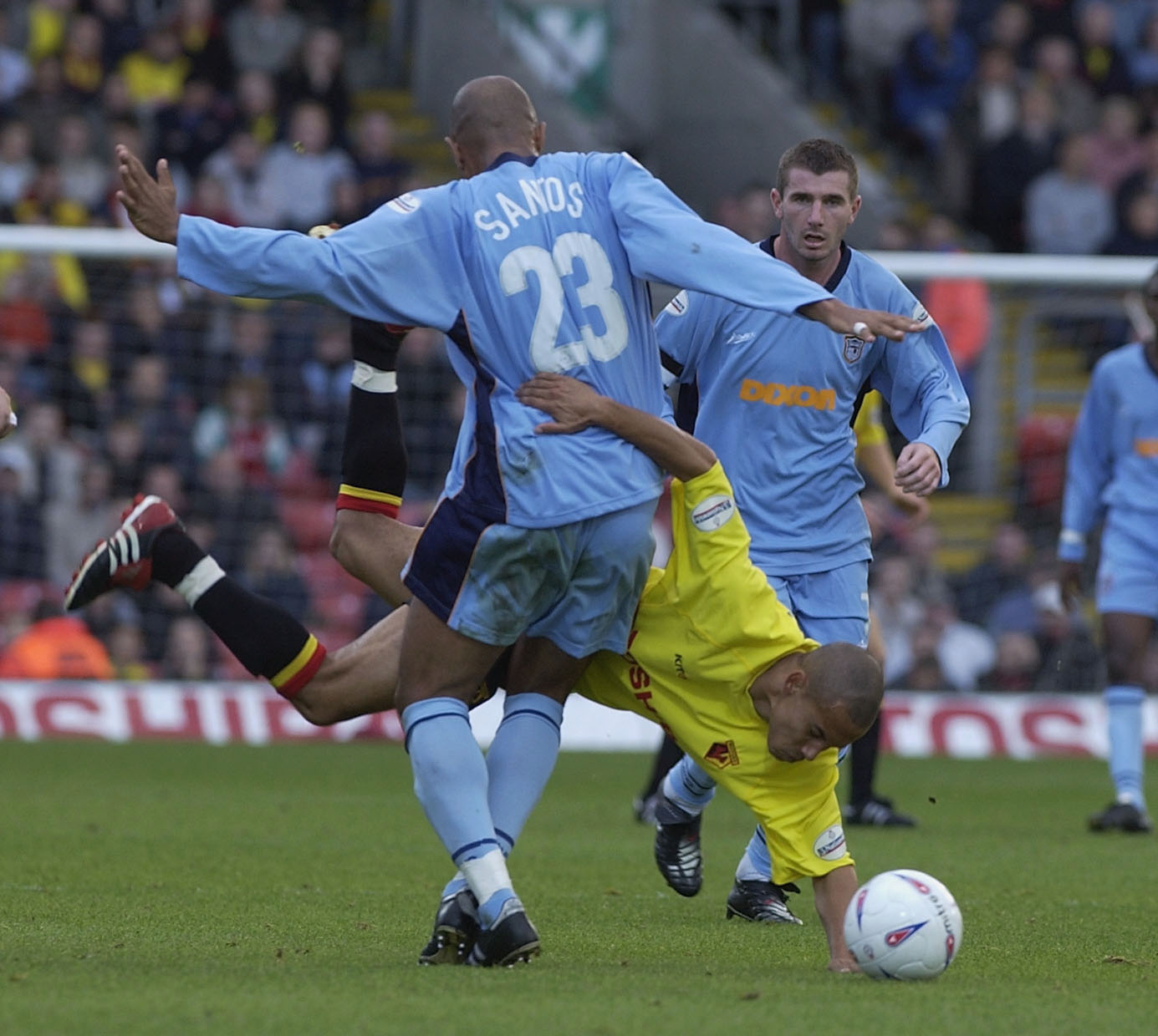 WATFORD - OCTOBER 12: Danny Webber of Watford is up-ended by Georges Santos of Grimsby during the Nationwide League Division One match between Watford and Grimsby Town at Vicarage Road, Watford, England on October 12, 2002. (Photo by Clive Brunskill/Getty