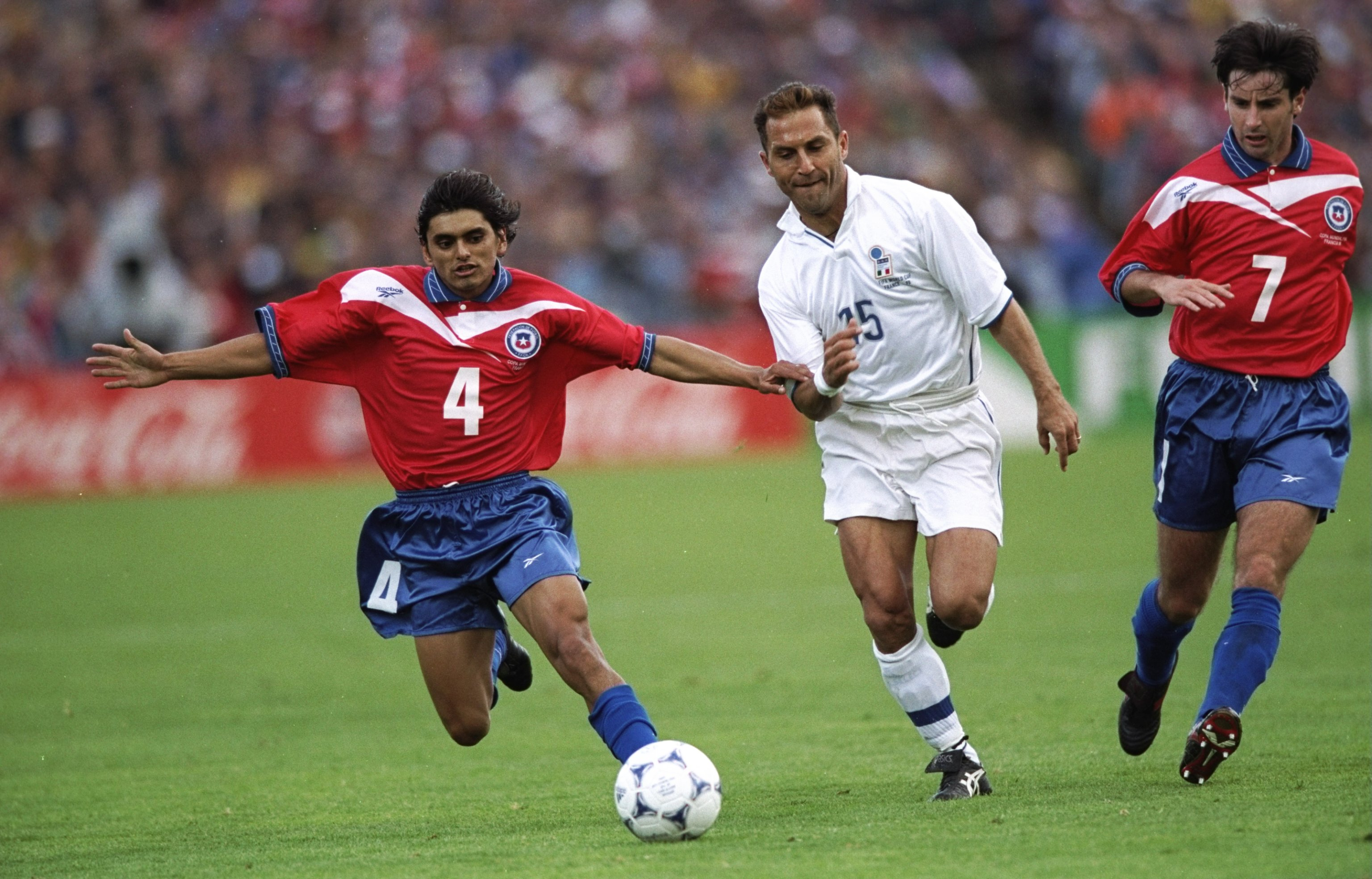 11 Jun 1998:  Angelo Di Livio of Italy takes on Francisco Rojas and Nelson Parraguez of Chile during the World Cup group B game at the Parc Lescure in Bordeaux, France. The match ended 2-2.  \ Mandatory Credit: Shaun Botterill /Allsport