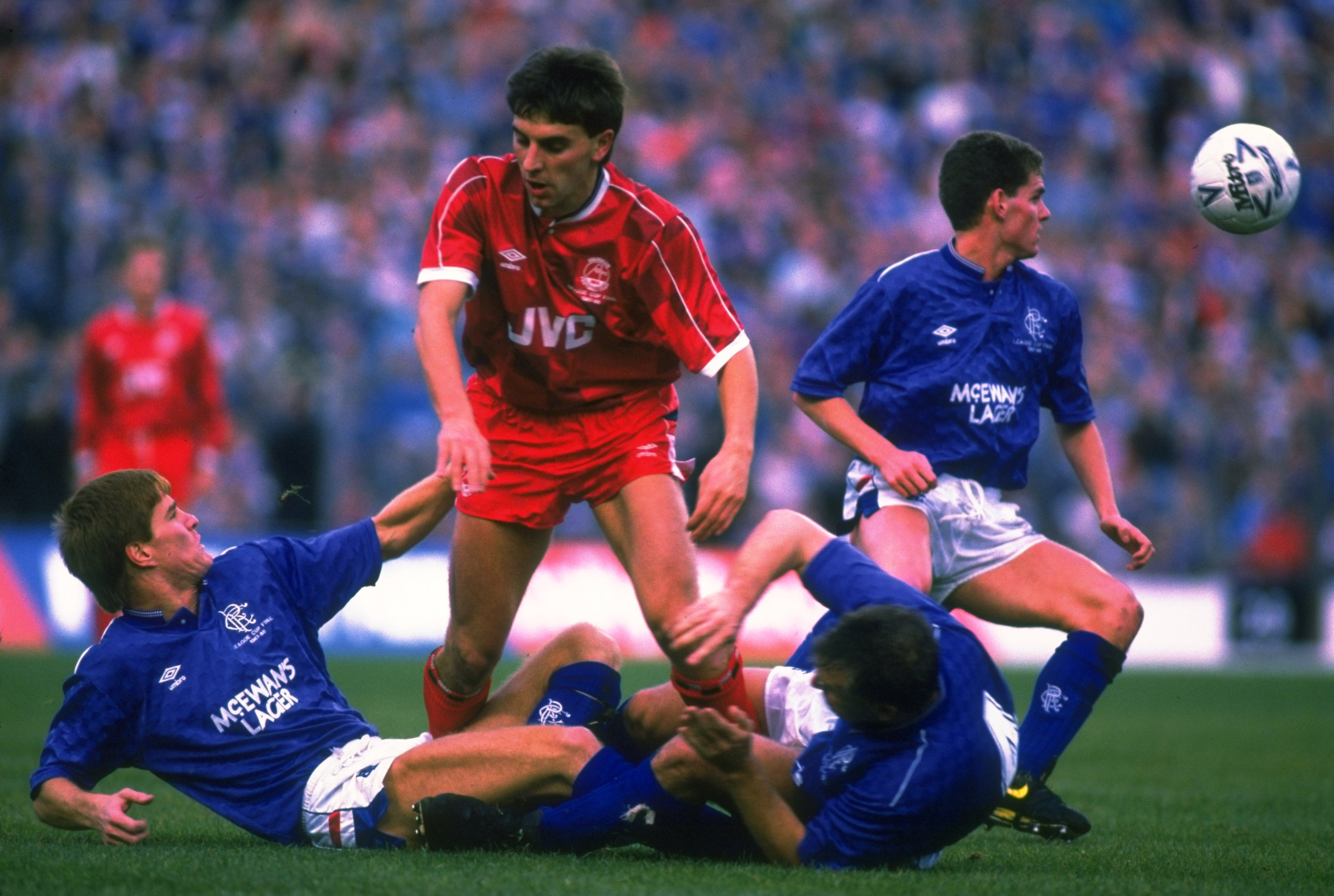 1988:  John Hewitt (centre) of Aberdeen helps up Richard Gough (bottom left) of Rangers while Graham Roberts (bottom right) of Rangers struggles to his feet during the Skol Cup Final match at Hampden Park in Glasgow, Scotland.The match ended in a 3-3 draw
