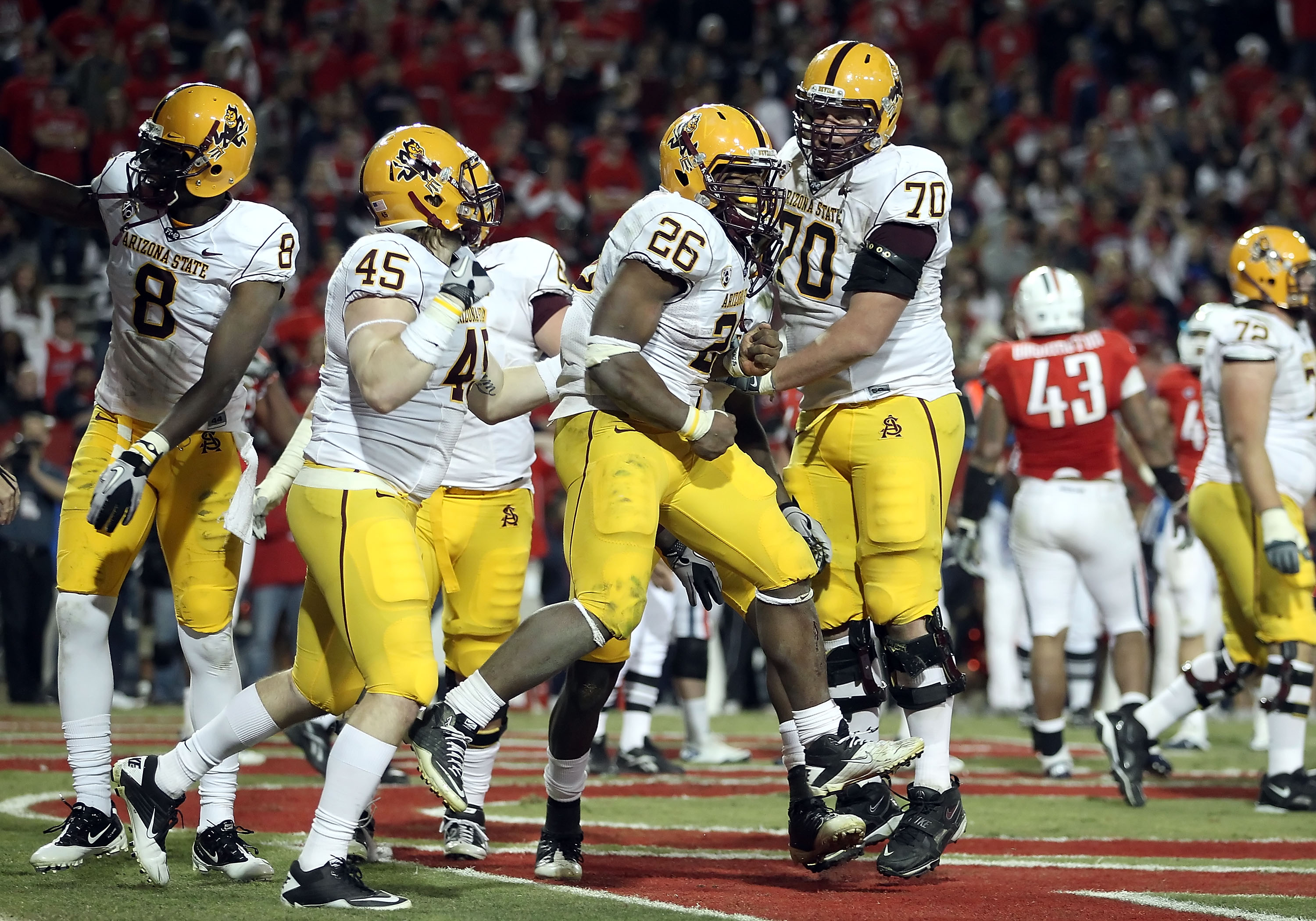 TUCSON, AZ - DECEMBER 02:  Runningback Cameron Marshall #26 of the Arizona State Sun Devils scores a rushing touchdown during the college football game at Arizona Stadium on December 2, 2010 in Tucson, Arizona. The Sun Devils defeated the Wildcats 30-29 i
