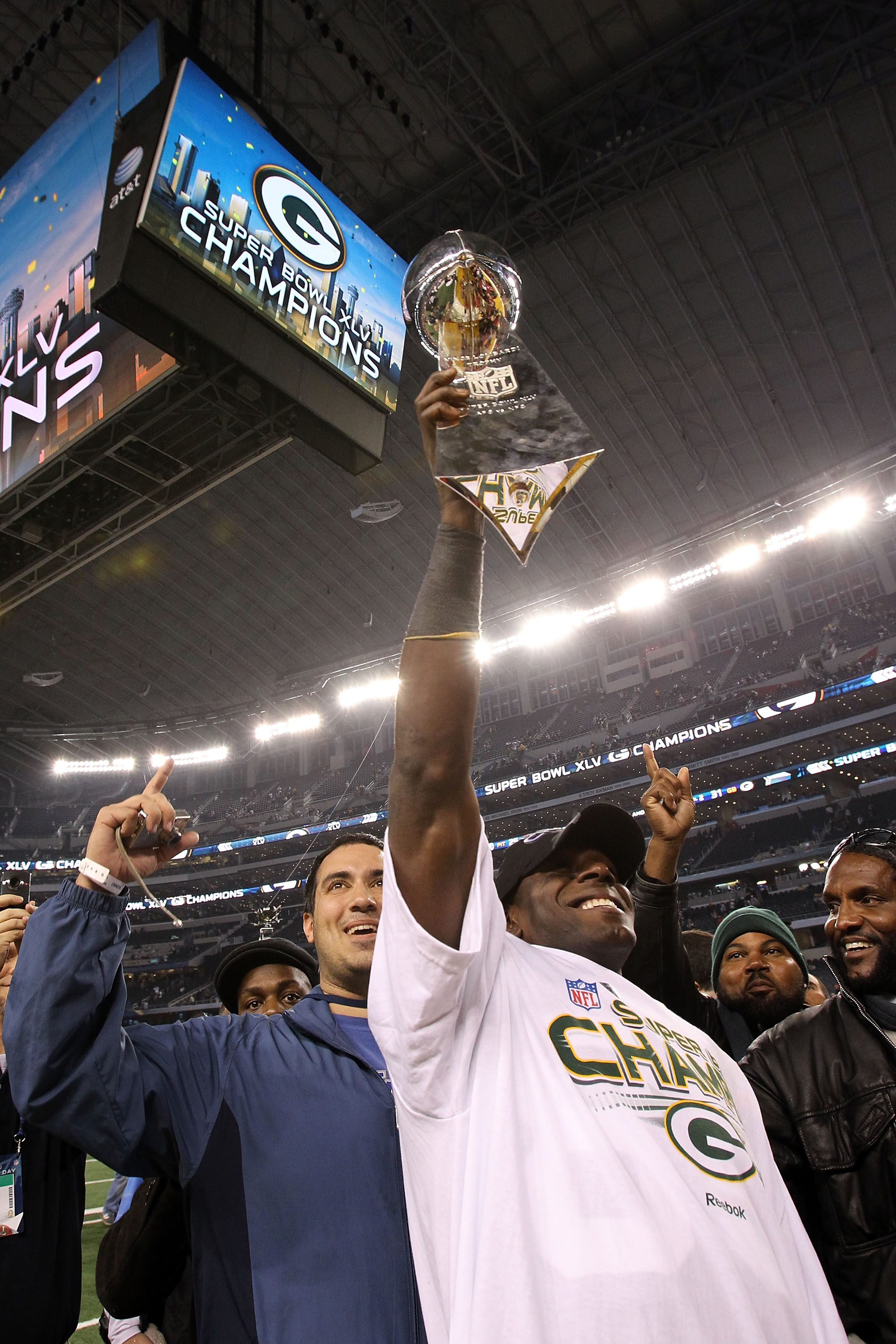 ARLINGTON, TX - FEBRUARY 06:  Donald Driver #80 of the Green Bay Packers celebrates with the Vince Lombardi Trophy after they defeated the Pittsburgh Steelers 31 to 25 in Super Bowl XLV at Cowboys Stadium on February 6, 2011 in Arlington, Texas.  (Photo b