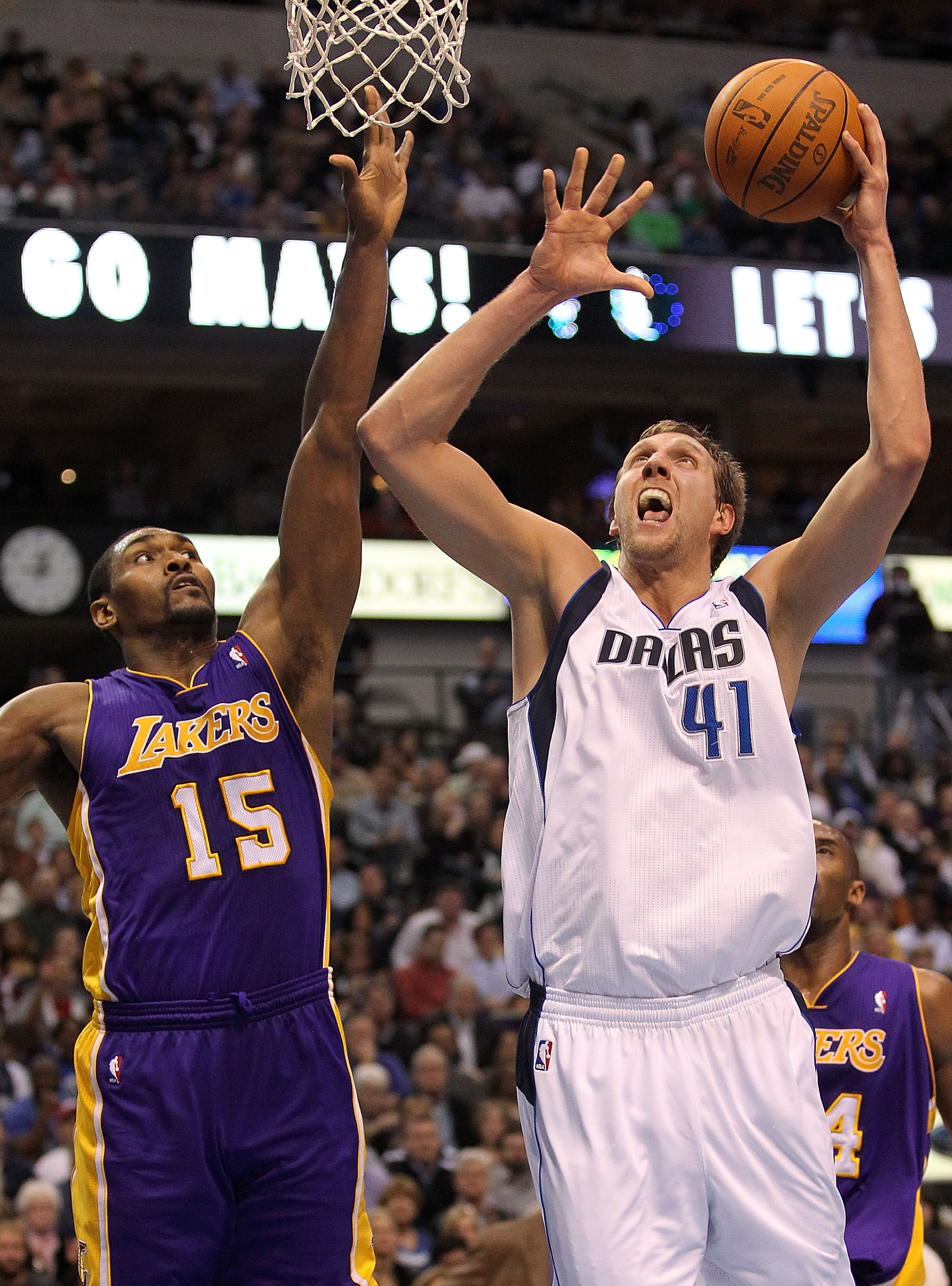 DALLAS, TX - JANUARY 19:  Forward Dirk Nowitzki #41 of the Dallas Mavericks takes a shot against Ron Artest #15 of the Los Angeles Lakers at American Airlines Center on January 19, 2011 in Dallas, Texas.  NOTE TO USER: User expressly acknowledges and agre