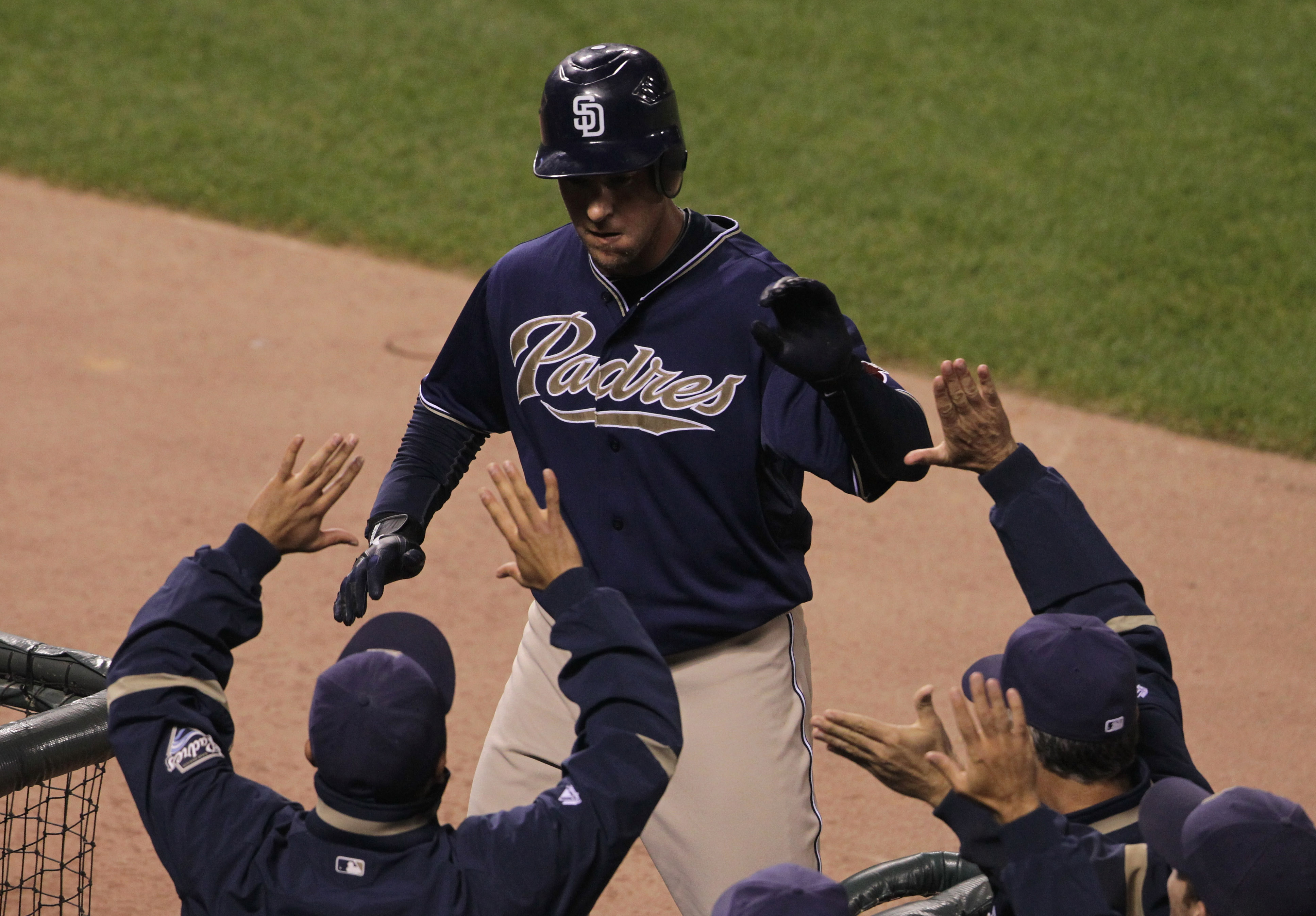 SAN FRANCISCO - OCTOBER 01:  Ryan Ludwick #47 of the San Diego Padres is congratulated by teammates after hitting a solo home run during the second inning against the San Francisco Giants October 1, 2010 in San Francisco, California.  (Photo by Justin Sul