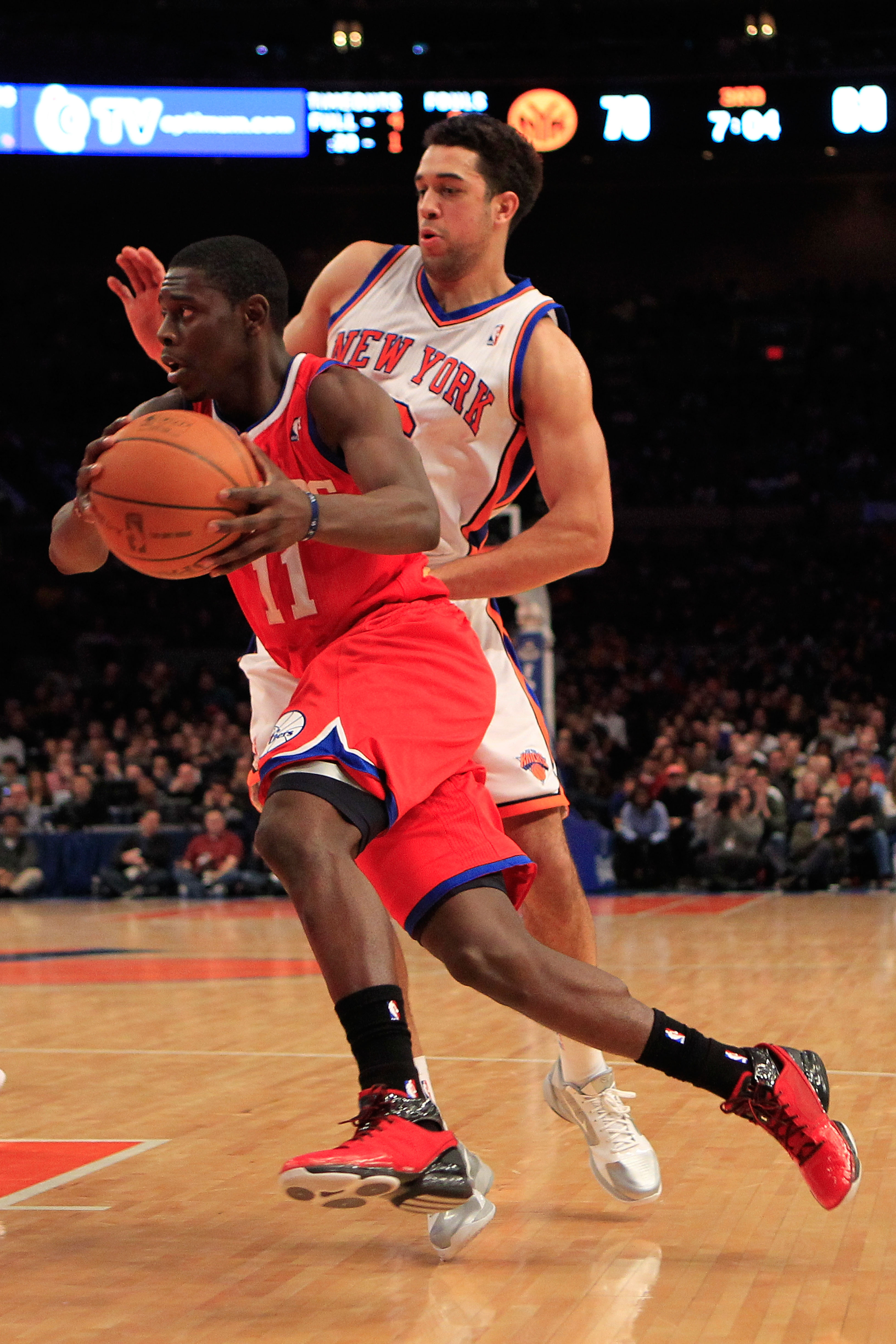 NEW YORK, NY - FEBRUARY 06: Jrue Holiday #11 of the Philadelphia 76ers drives past Landry Fields #6 of the New York Knicks at Madison Square Garden on February 6, 2011 in New York City. NOTE TO USER: User expressly acknowledges and agrees that, by downloa