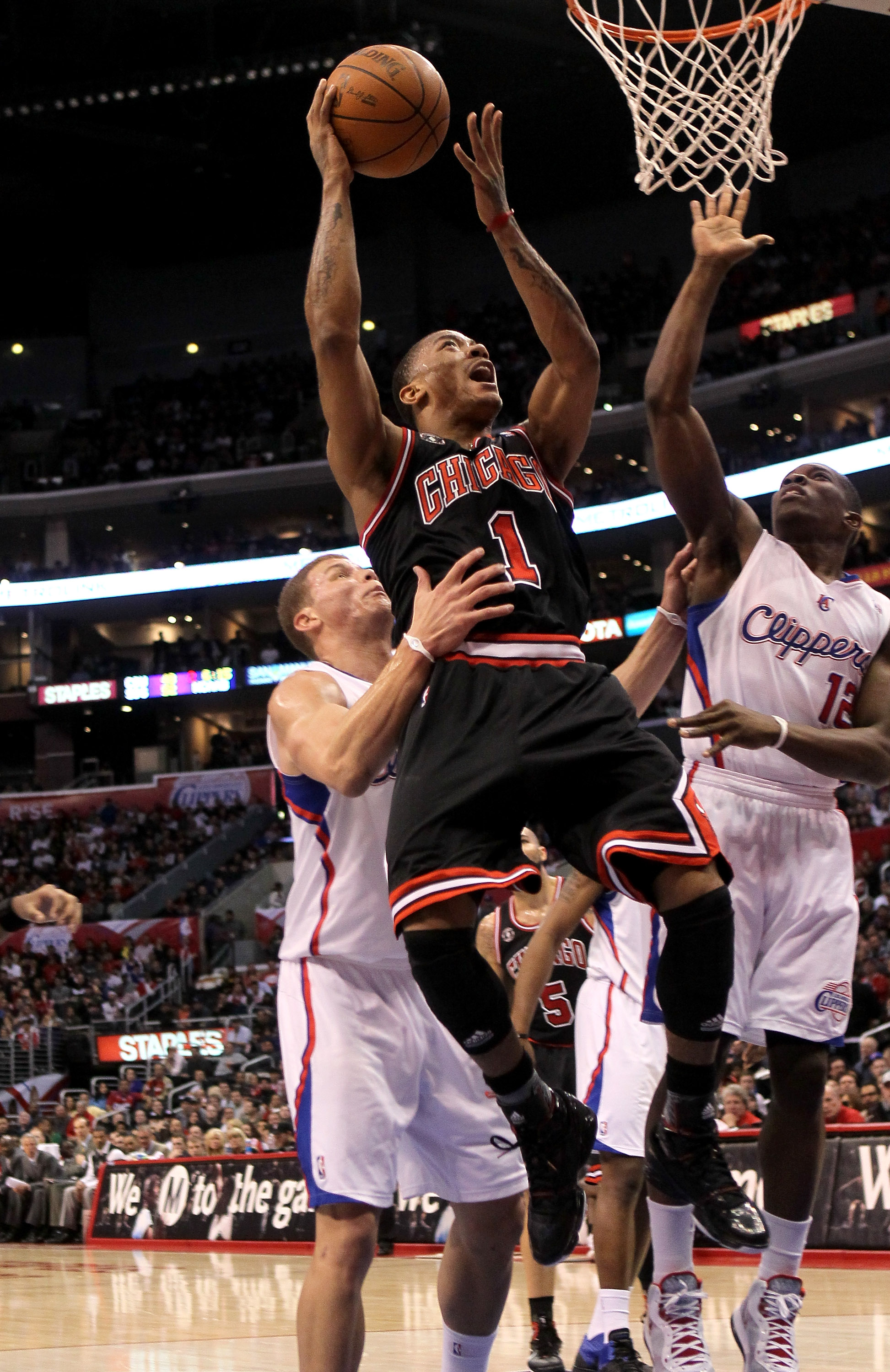 LOS ANGELES, CA - FEBRUARY 02:  Derrick Rose #1 of the Chicago Bulls goes up for a shot over Blake Griffin #32 and Eric Bledsoe #12 of the Los Angeles Clippers at Staples Center on February 2, 2011  in Los Angeles, California.  NOTE TO USER: User expressl