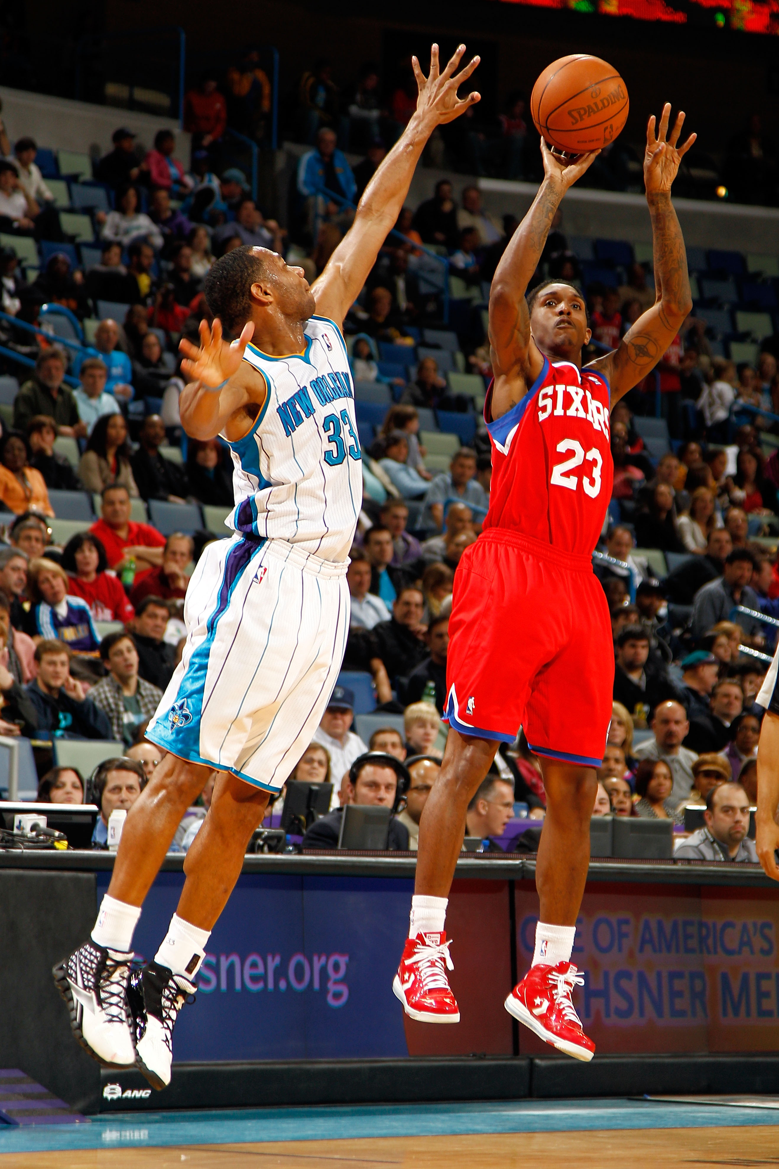 NEW ORLEANS, LA - JANUARY 03:  Lou Williams #23 of the Philadelphia 76ers shoots over Willie Green #33 of the New Orleans Hornets at New Orleans Arena on January 3, 2011 in New Orleans, Louisiana. NOTE TO USER: User expressly acknowledges and agrees that,