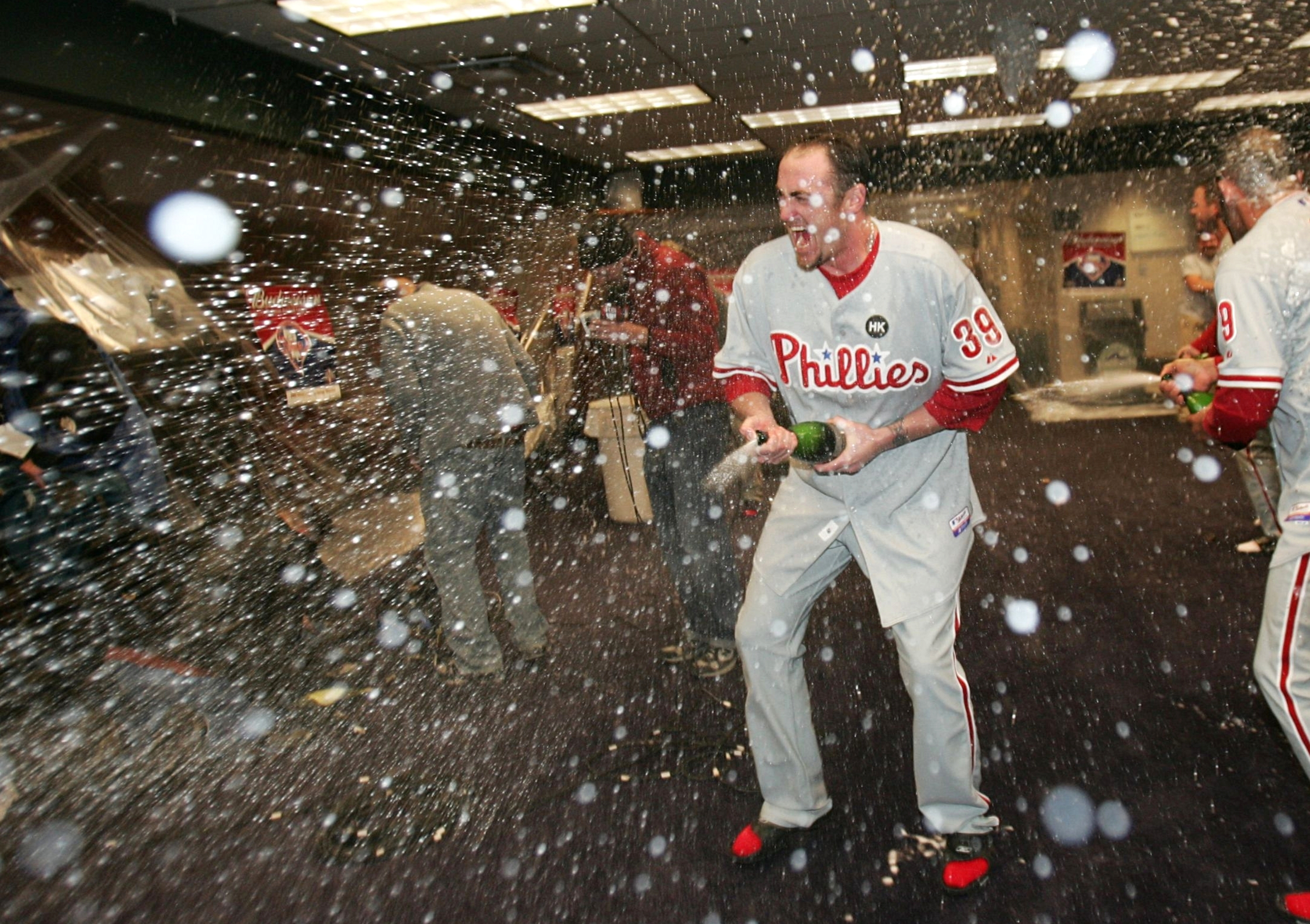 DENVER - OCTOBER 12:  Brett Myers #39 of the Philadelphia Phillies sprays champagne in the locker room after the victory against the Colorado Rockies in Game Four of the NLDS during the 2009 MLB Playoffs at Coors Field on October 12, 2009 in Denver, Color