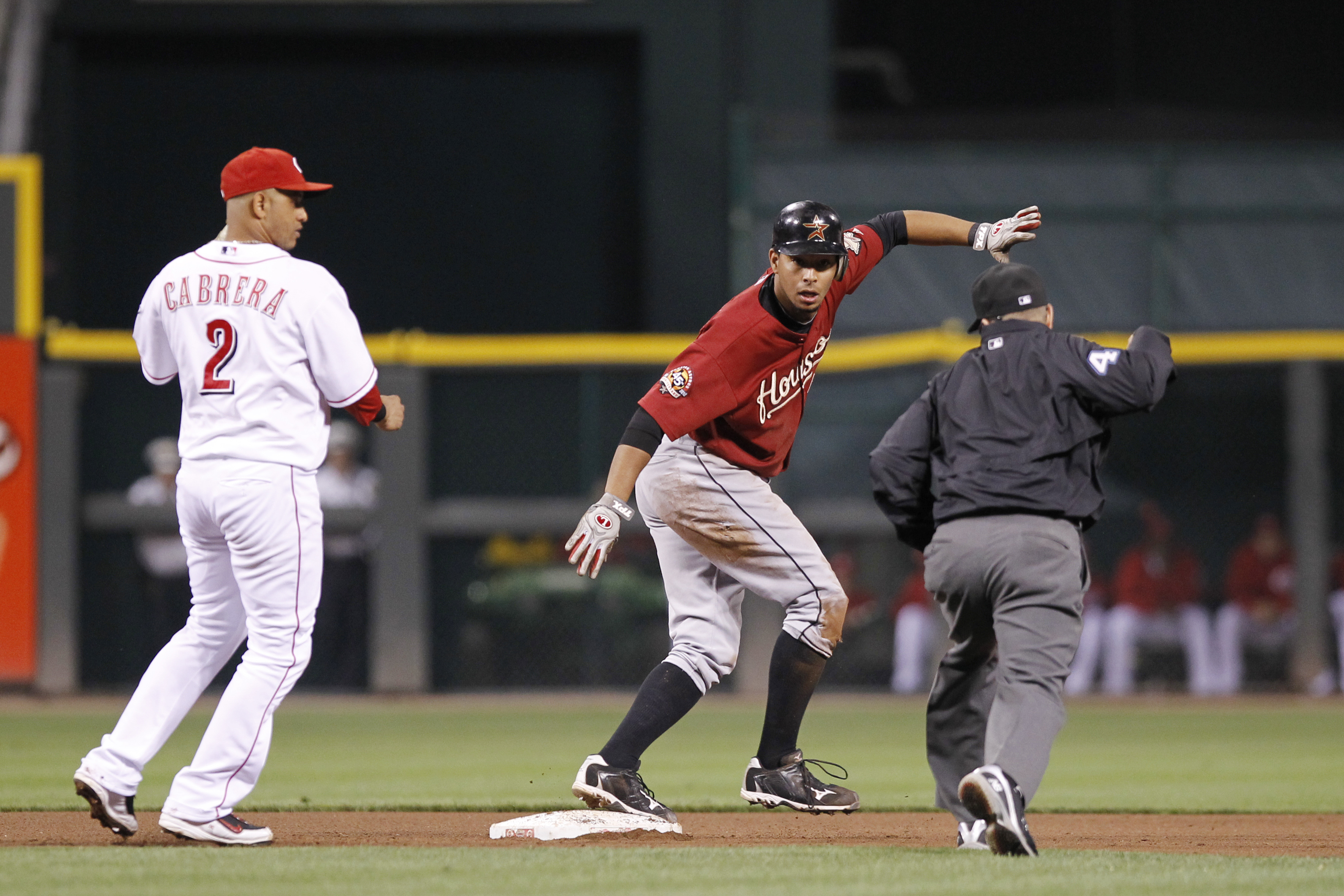 CINCINNATI, OH - SEPTEMBER 28: Angel Sanchez #36 of the Houston Astros looks at second base umpire Jerry Meals after being tagged out by Orlando Cabrera #2 of the Cincinnati Reds at Great American Ball Park on September 28, 2010 in Cincinnati, Ohio. The R