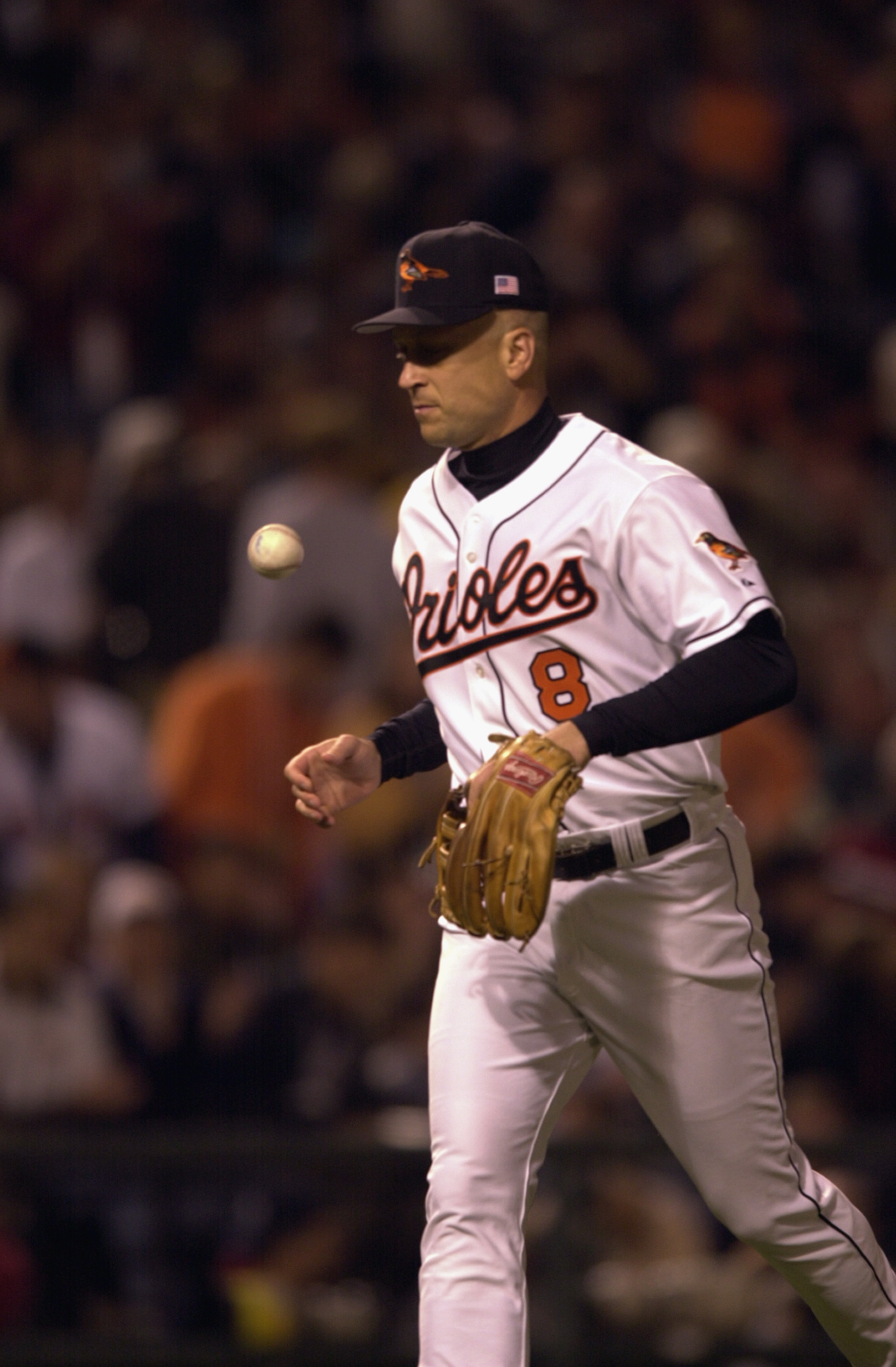 BALTIMORE - OCTOBER 6:  On the 3001st and final game of his career, Cal Ripken Jr. #8 of the Baltimore Orioles retires to the dugout so the Boston Red Sox can take the field at Camden Yards in Baltimore, Maryland. The Red Sox won, 2-0.  (Photo by: Doug Pe