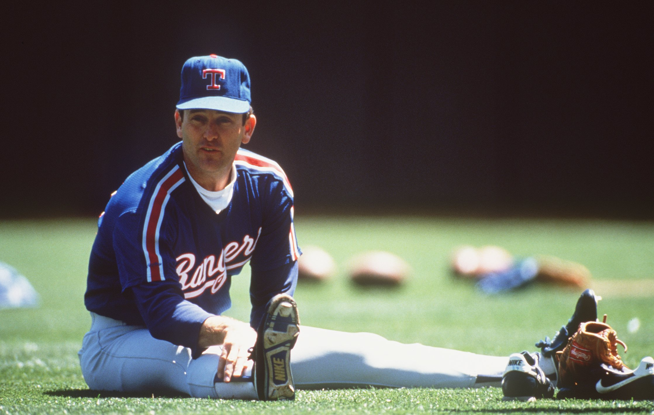 UNDATED:  TEXAS RANGERS PITCHER NOLAN RYAN STRETCHES BEFORE THROWING . Mandatory Credit: Otto Greule/ALLSPORT