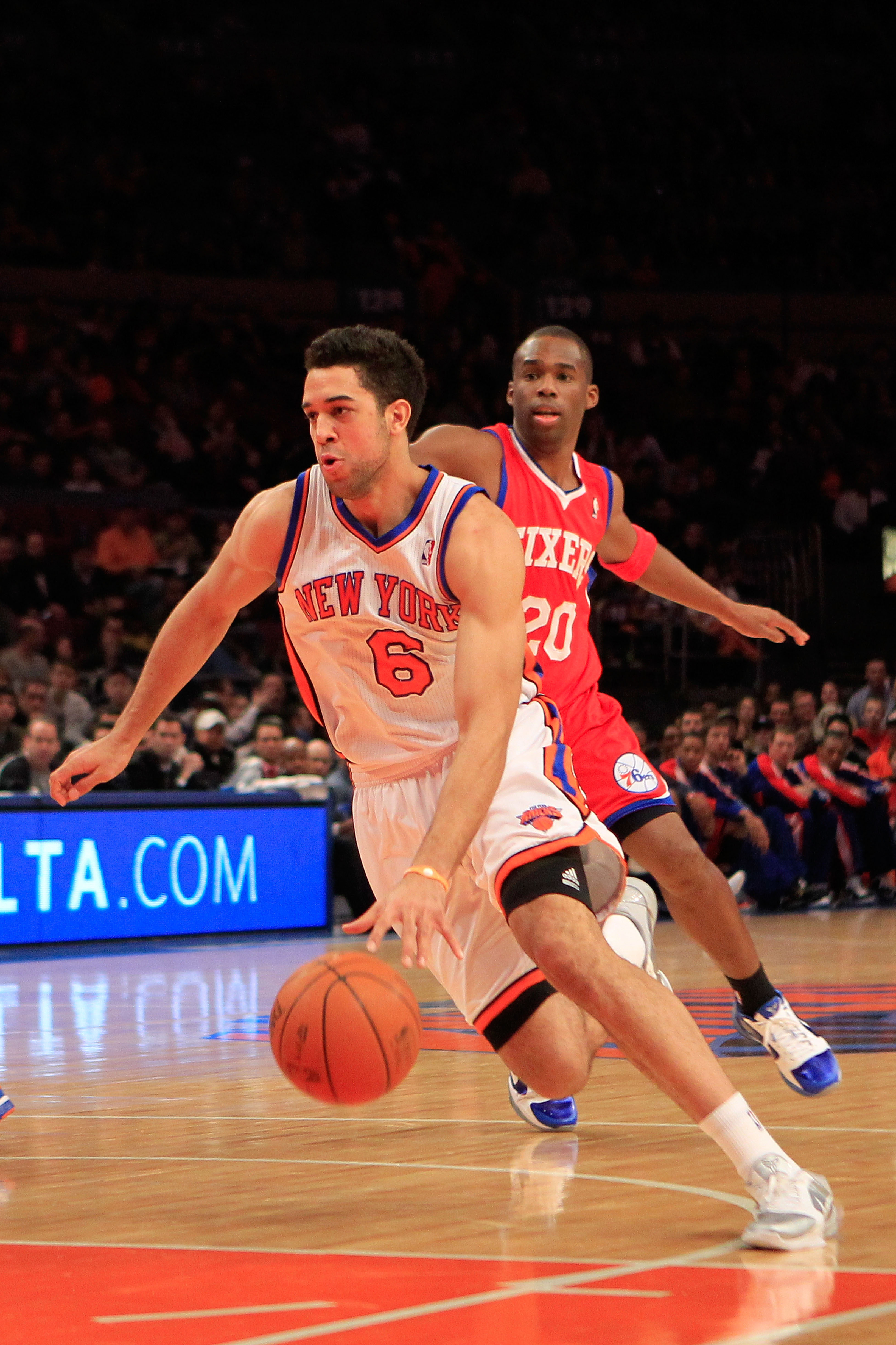 NEW YORK, NY - FEBRUARY 06:  Landry Fields #6 of the New York Knicks drives past Jodie Meeks #20 of the Philadelphia 76ers at Madison Square Garden on February 6, 2011 in New York City. NOTE TO USER: User expressly acknowledges and agrees that, by downloa