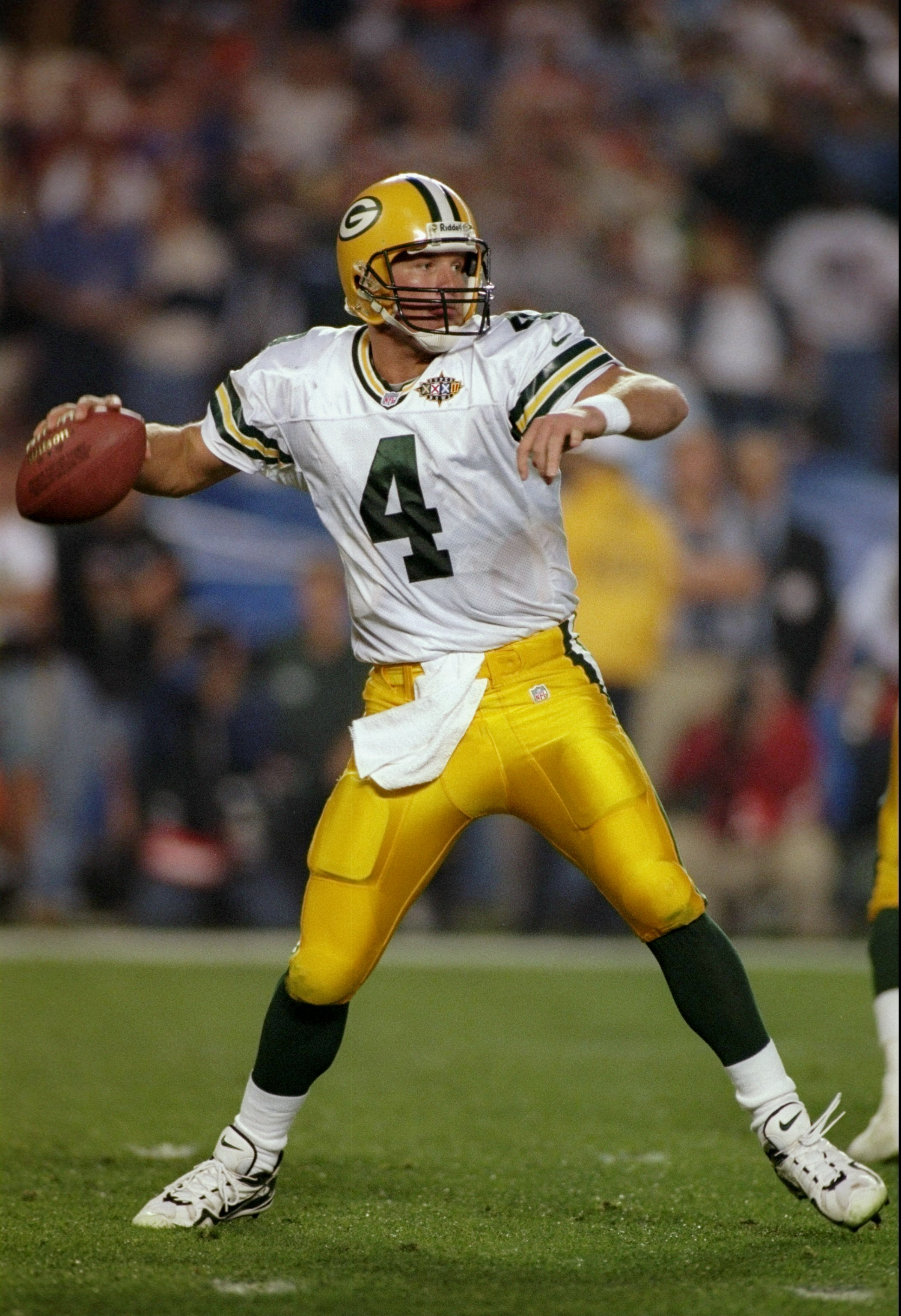 25 Jan 1998:  Brett Favre #4 of the Green Bay Packers sets to throw a pass against the Denver Broncos during Super Bowl  XXXII at Qualcomm Stadium in San Diego, California.  The Denver Broncos defeated the Green Bay Packers 31-24. Mandatory Credit: Al Bel