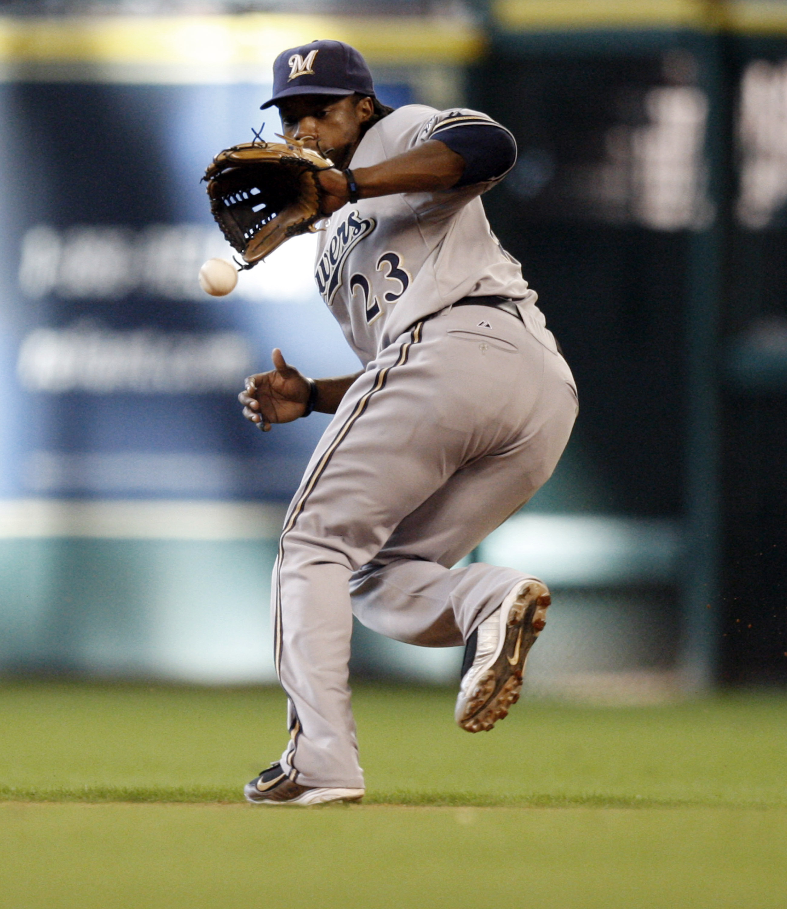 HOUSTON - SEPTEMBER 15:  Second baseman Rickie Weeks #23 of the Milwaukee Brewers makes a backhand stab on a ball hit up the middle by the Houston Astros at Minute Maid Park on September 15, 2010 in Houston, Texas.  (Photo by Bob Levey/Getty Images)