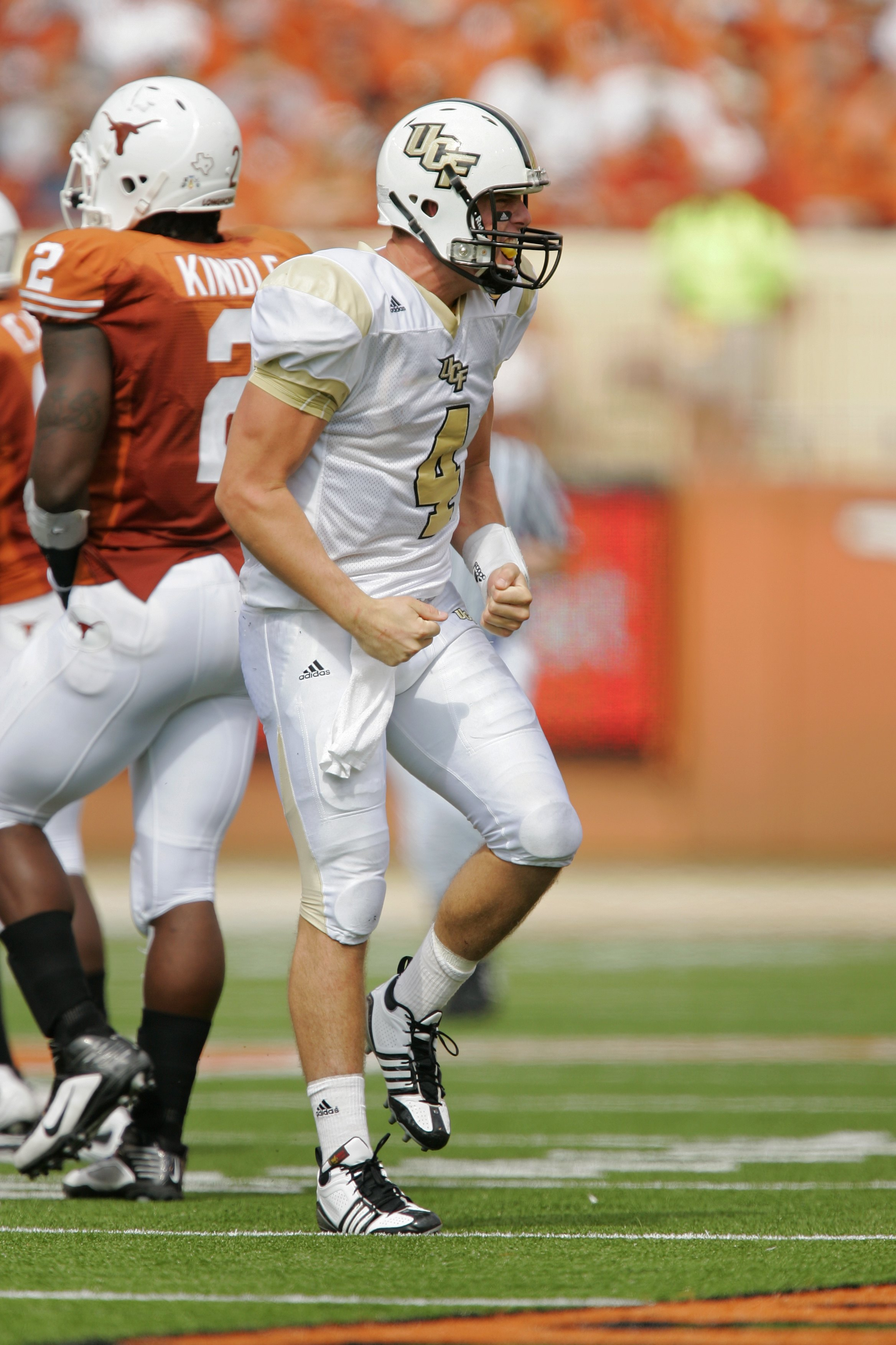 AUSTIN, TX - NOVEMBER 07:  Quarterback Rob Calabrese #4 of the UCF Knights celebrates a first down against the Texas Longhorns on November 7, 2009 at Darrell K Royal - Texas Memorial Stadium in Austin, Texas.  Texas won 35-3.  (Photo by Brian Bahr/Getty I