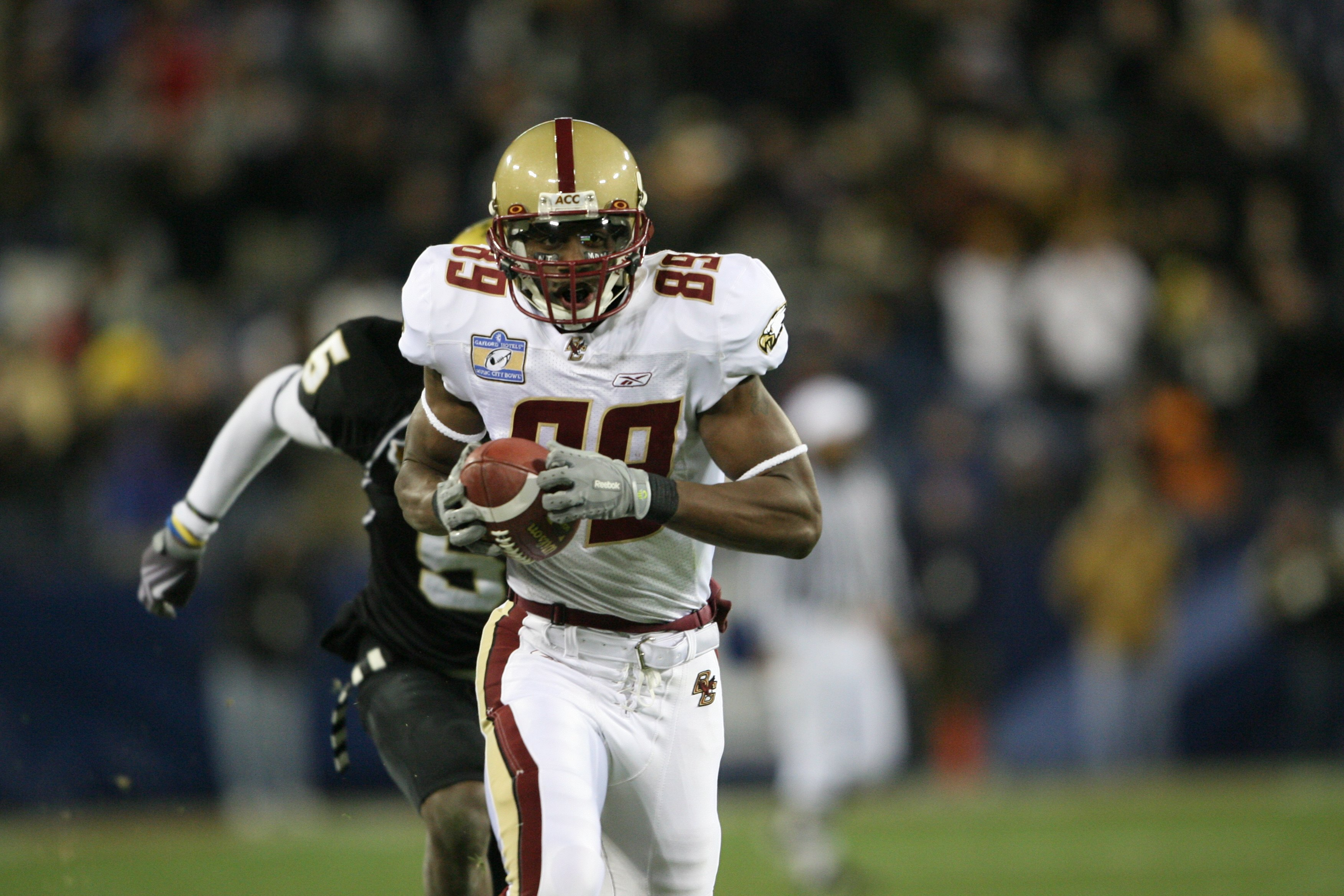 NASHVILLE, TN - DECEMBER 31:  Colin Larmond Jr. #89 of the Boston College Eagles carries the ball against the Vanderbilt Commodores during the Gaylord Hotels Music City Bowl at LP Field on December 31, 2008 in Nashville, Tennessee.  (Photo by Andy Lyons/G