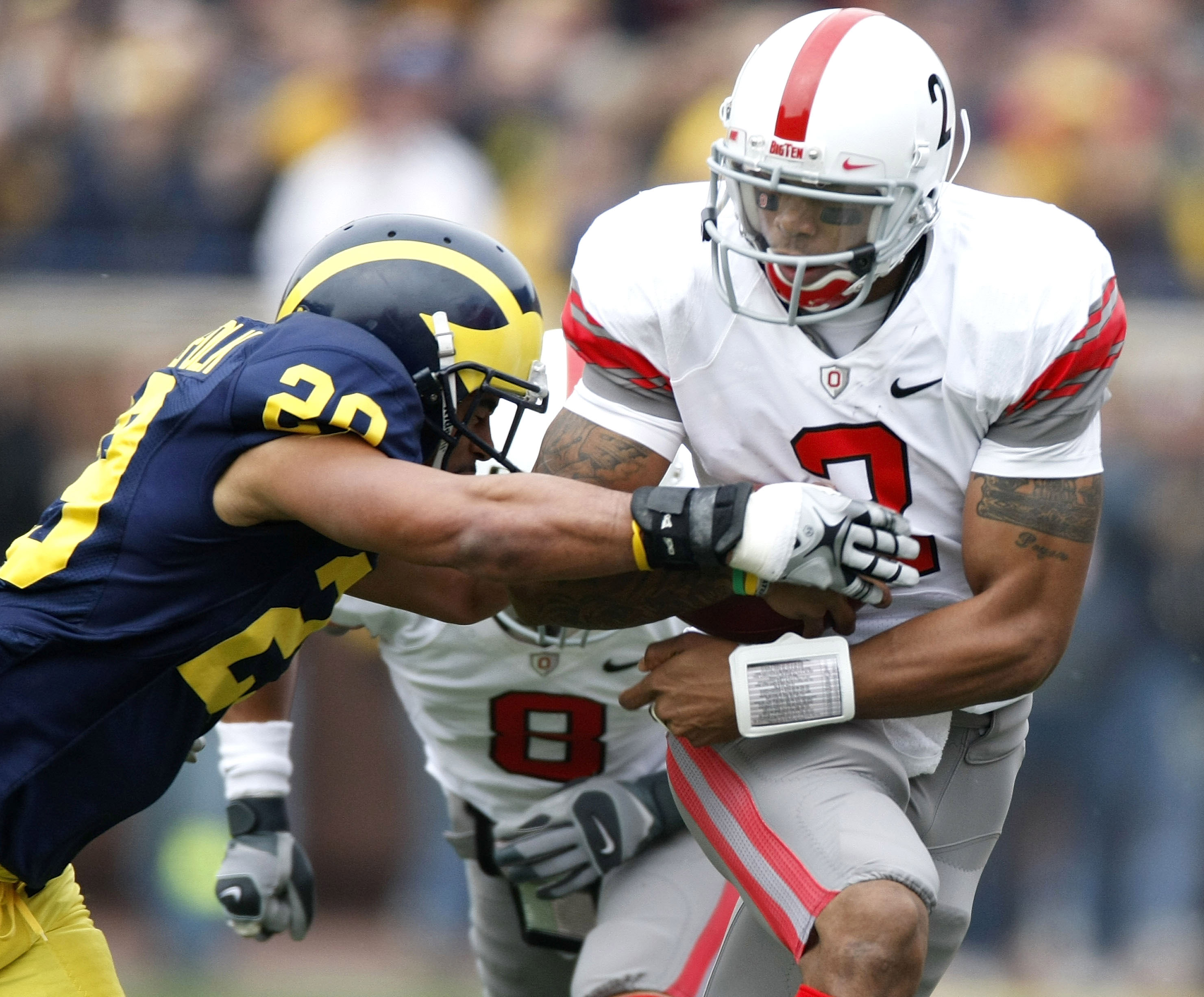 ANN ARBOR, MI - NOVEMBER 21:  Terrelle Pryor #2 of the Ohio State Buckeyes tries to get around Troy Woolfolk #29 of the Michigan Wolverines on November 21, 2009 at Michigan Stadium in Ann Arbor, Michigan.  (Photo by Gregory Shamus/Getty Images)