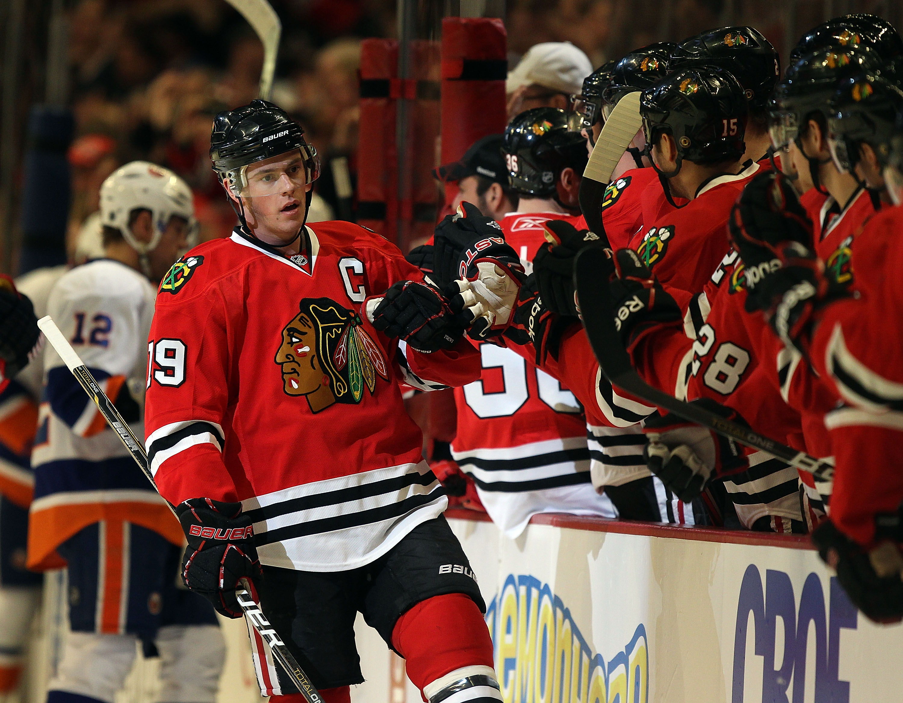 CHICAGO, IL - JANUARY 09: Jonathan Toews #19 of the Chicago Blackhawks is congratulated by teammates after a goal was scored by Patrick Sharp against the New York Islanders at the United Center on January 9, 2011 in Chicago, Illinois. The Blackhawks defea