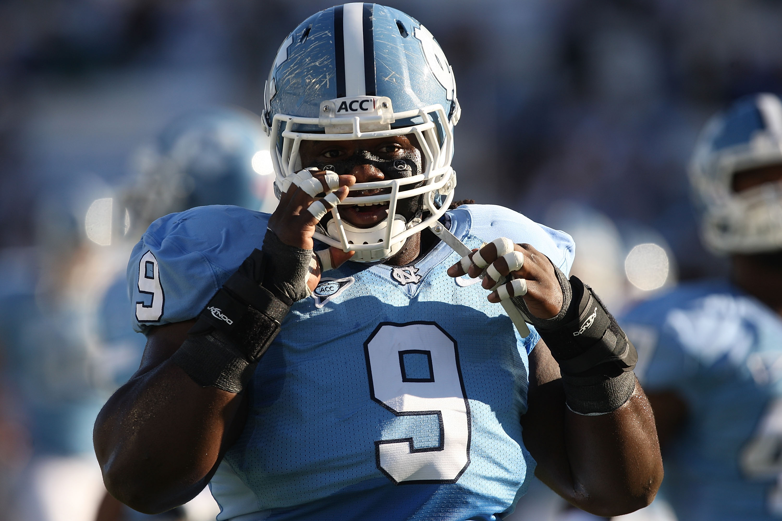 CHAPEL HILL, NC - NOVEMBER 07:  Marvin Austin #9 of the North Carolina Tar Heels watches on against the Duke Blue Devils during their game at Kenan Stadium on November 7, 2009 in Chapel Hill, North Carolina.  (Photo by Streeter Lecka/Getty Images)