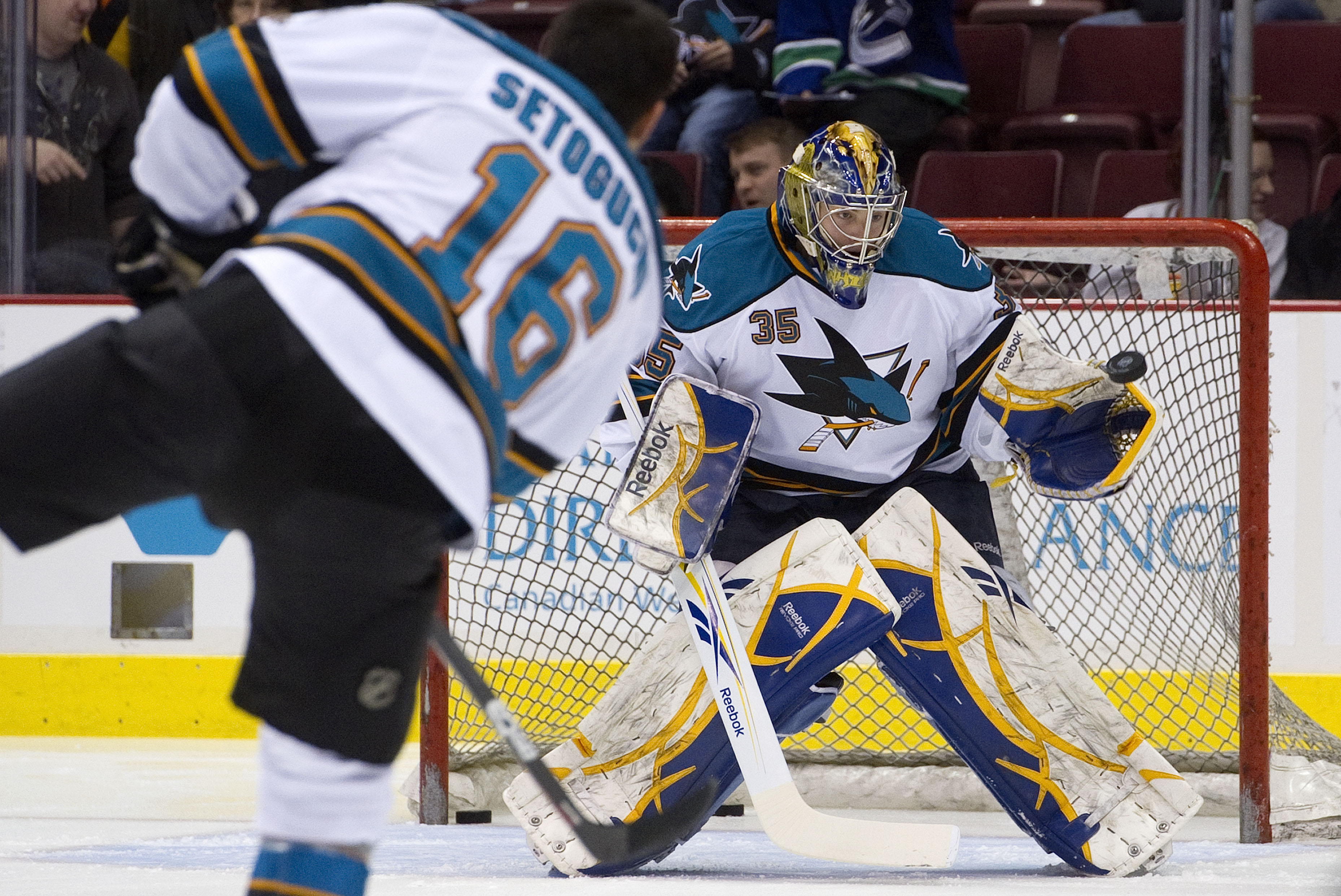 VANCOUVER, CANADA - JANUARY 20: Backup goalie Jordan White #35 of the San Jose Sharks makes a glove save on Devin Setoguchi #16 during pre game skate prior to NHL action against the Vancouver Canucks on January 20, 2011 at Rogers Arena in Vancouver, BC, C