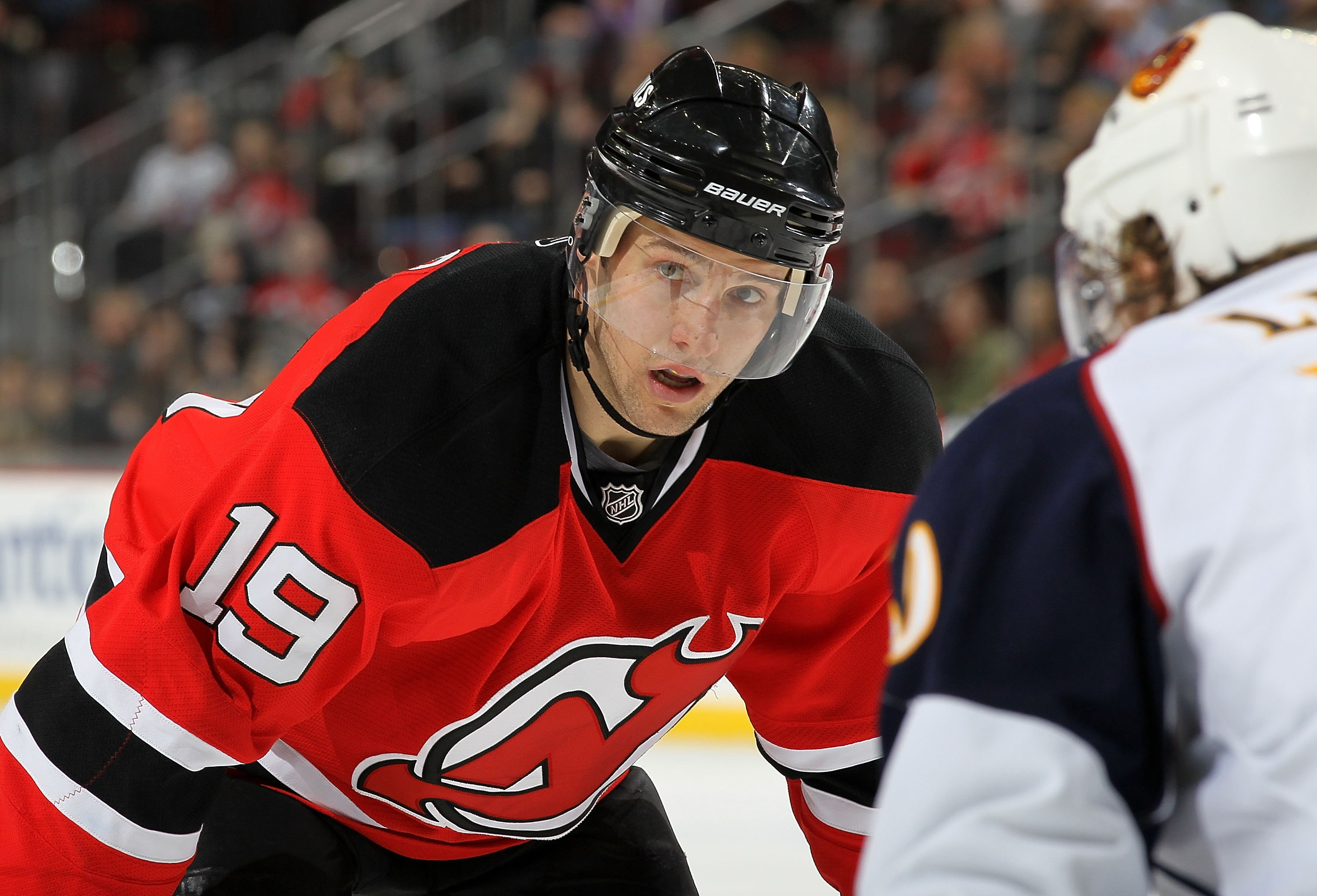 NEWARK, NJ - DECEMBER 31:  Travis Zajac #19 of the New Jersey Devils looks on against the Atlanta Thrashers at the Prudential Center on December 31, 2010 in Newark, New Jersey.  (Photo by Jim McIsaac/Getty Images)