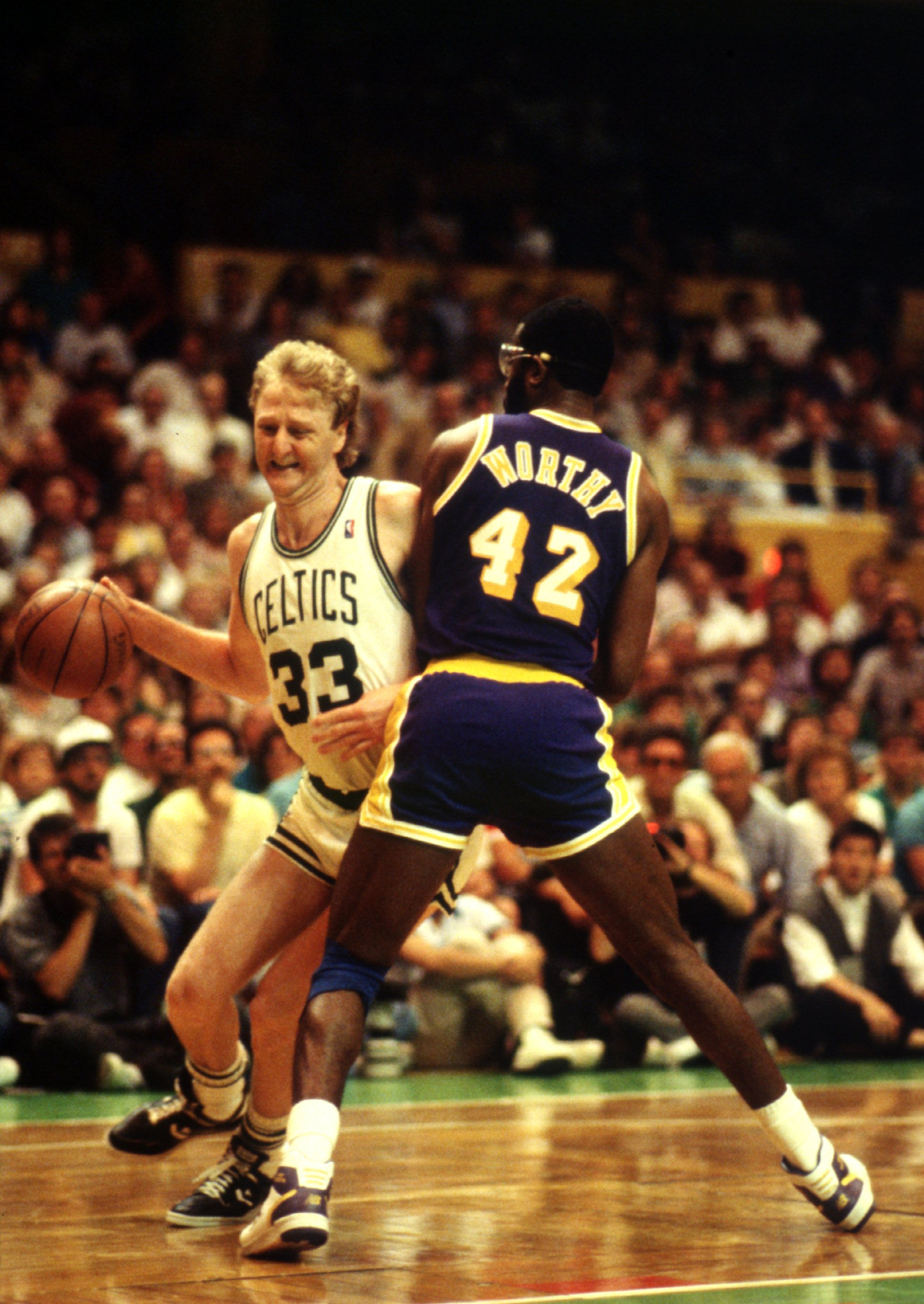 JUN 1987:  BOSTON FORWARD LARRY BIRD TRIES TO DRIVE AROUND LOS ANGELES FORWARD JAMES WORTHY DURING THE CELTICS GAME VERSUS THE LAKERS IN THE NBA FINALS AT THE BOSTON GARDEN IN  BOSTON, MASSACHUSETTS. Mandatory Credit: Jonathan Daniel/ALLSPORT
