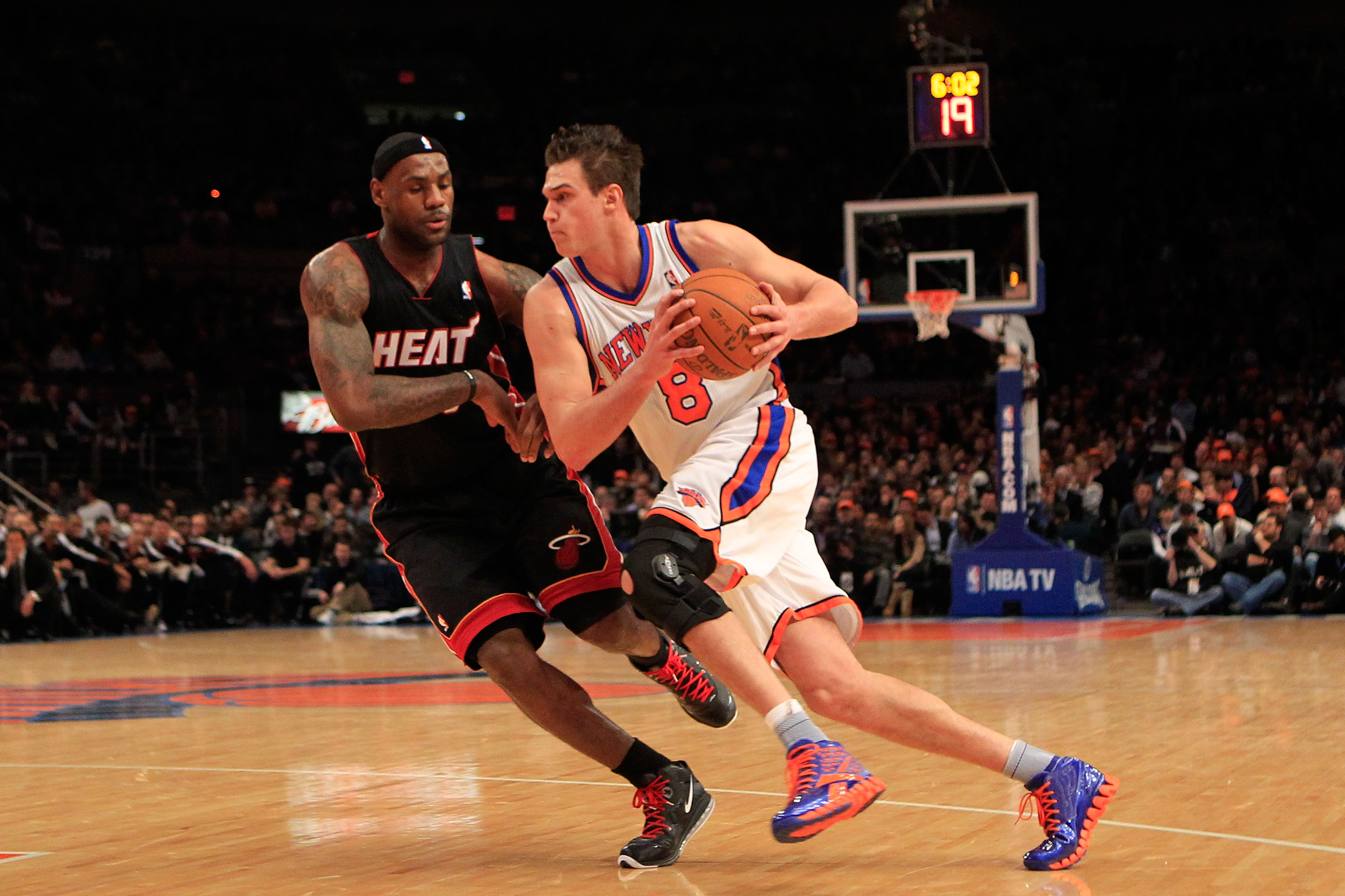 NEW YORK, NY - JANUARY 27:  Danilo Gallinari #8 of the New York Knicks drives past LeBron James #6 of the Miami Heat at Madison Square Garden on January 27, 2011 in New York City. NOTE TO USER: User expressly acknowledges and agrees that, by downloading a