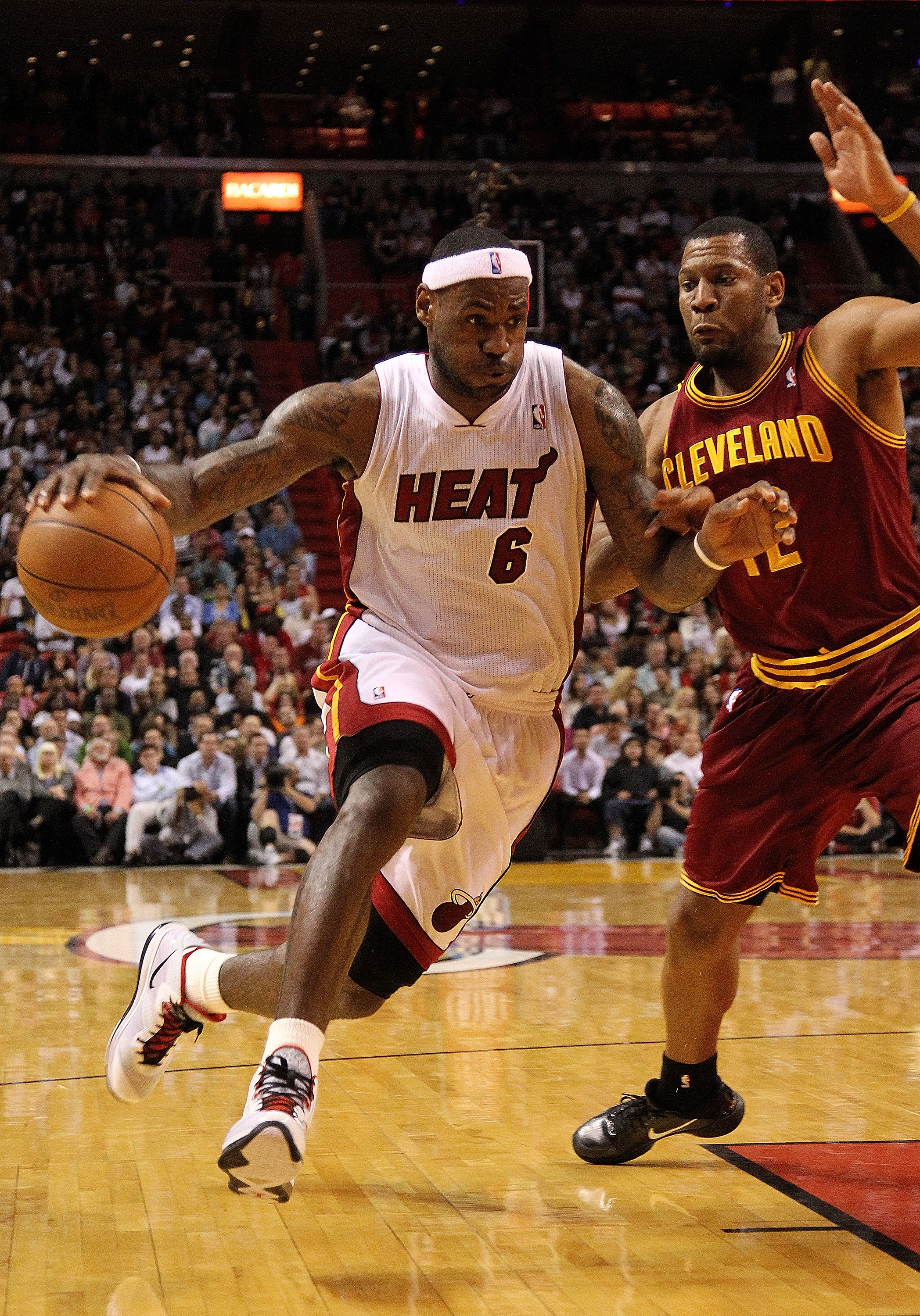 MIAMI, FL - JANUARY 31:  LeBron James #6 of the Miami Heat drives the lane during a game against the Cleveland Cavaliers at American Airlines Arena on January 31, 2011 in Miami, Florida. NOTE TO USER: User expressly acknowledges and agrees that, by downlo