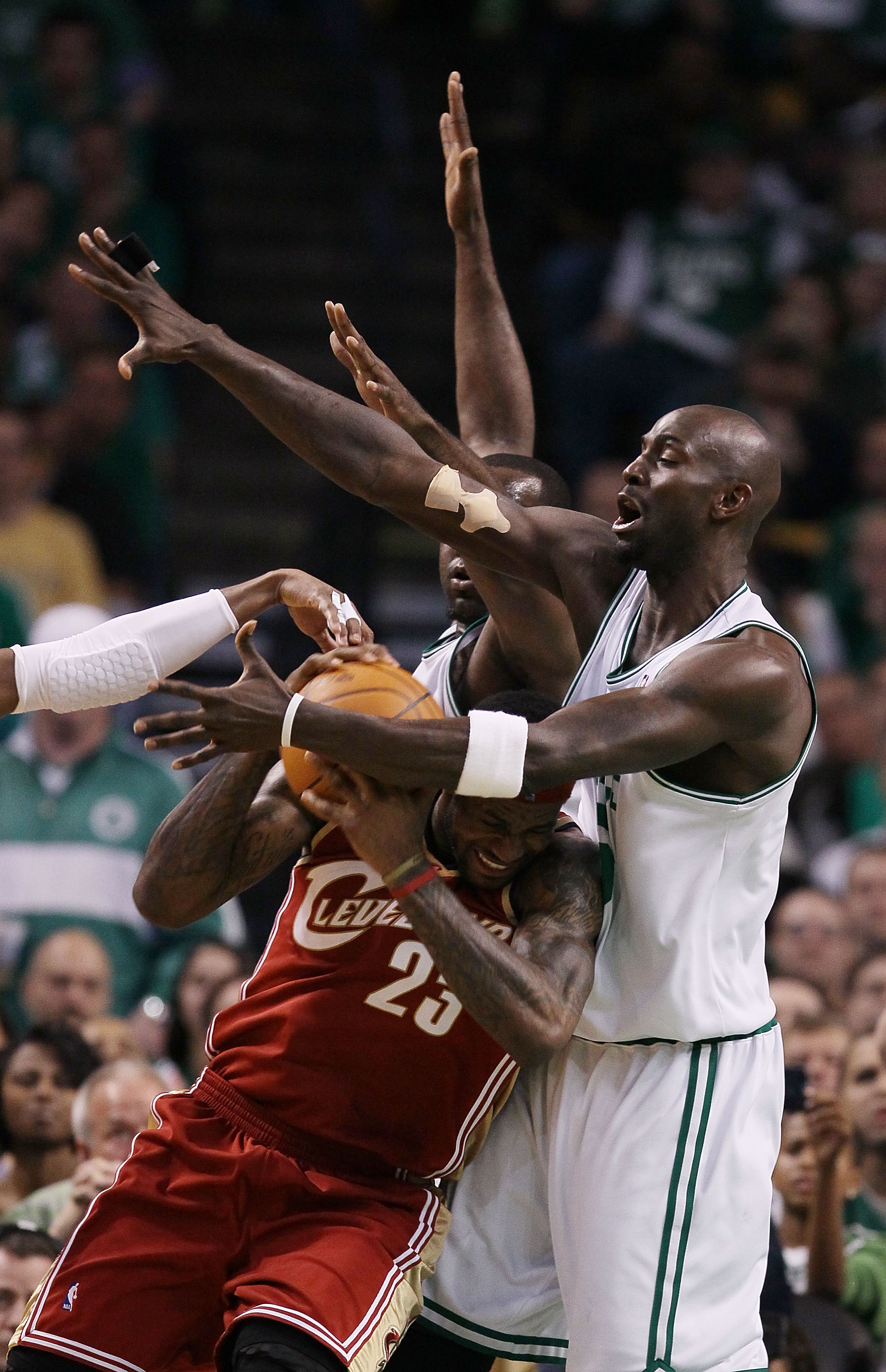 BOSTON - MAY 13:  Kevin Garnett #5 and Kendrick Perkins #43 of the Boston Celtics keep LeBron James #23 of the Cleveland Cavaliers from the basket in the first half during Game Six of the Eastern Conference Semifinals of the 2010 NBA playoffs at TD Garden