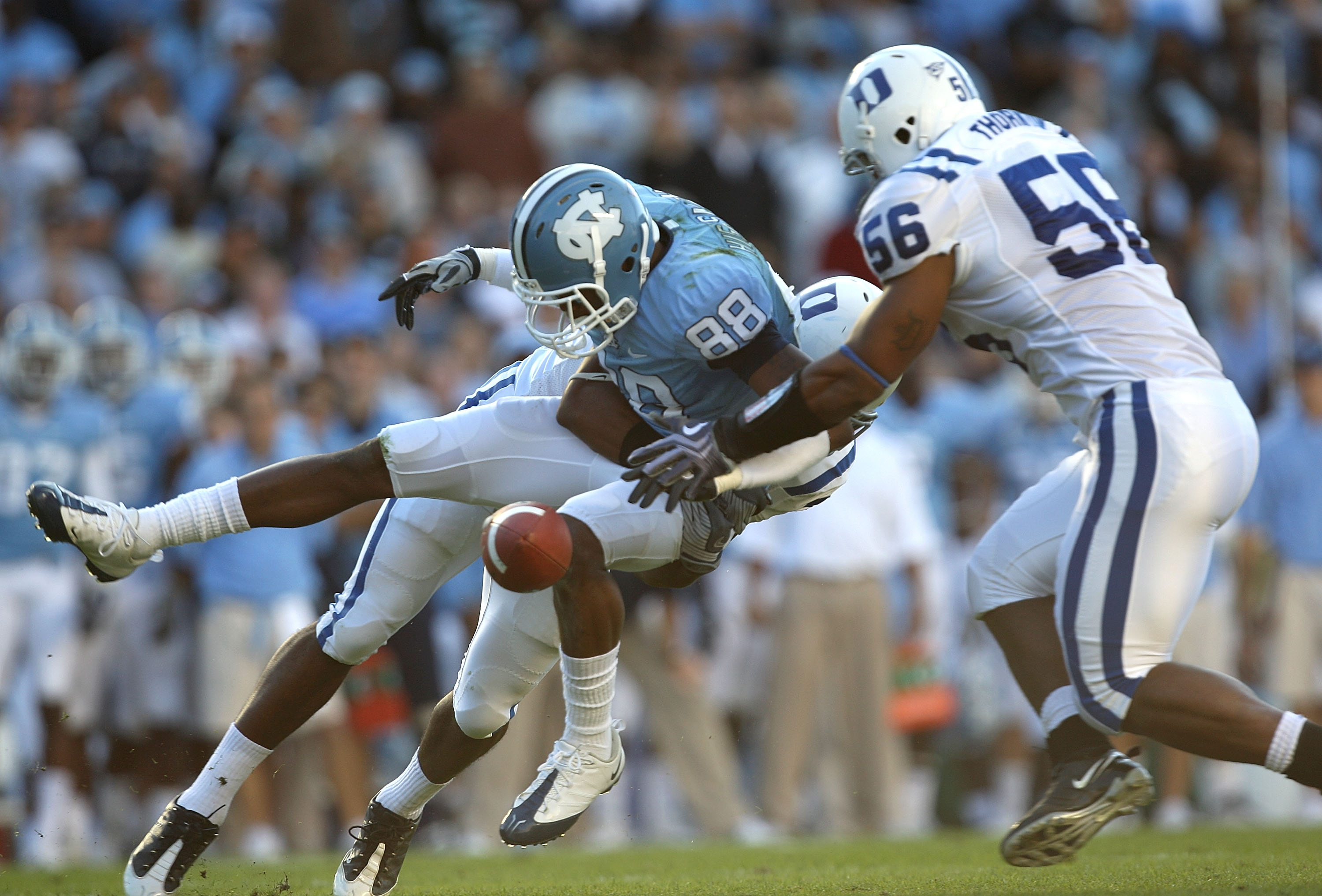 CHAPEL HILL, NC - NOVEMBER 07:  Damian Thornton #56 of the Duke Blue Devils goes after a dropped ball by Erik Highsmith #88 of the North Carolina Tar Heels during their game at Kenan Stadium on November 7, 2009 in Chapel Hill, North Carolina.  (Photo by S