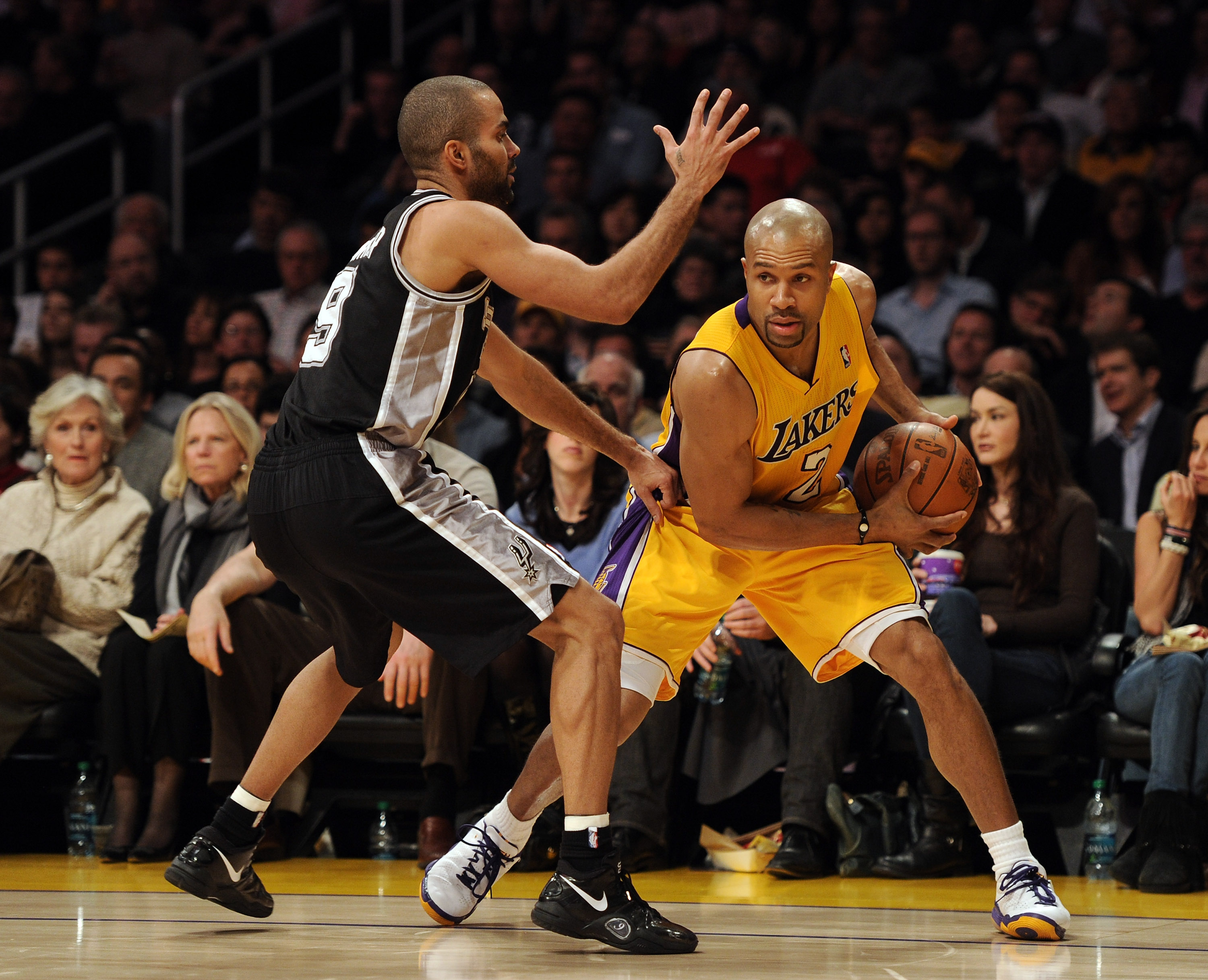 LOS ANGELES, CA - FEBRUARY 03:  Derek Fisher #2 of the Los Angeles Lakers is guarded by Tony Parker #9 of the San Antonio Spurs at Staples Center on February 3, 2011 in Los Angeles, California.  NOTE TO USER: User expressly acknowledges and agrees that, b