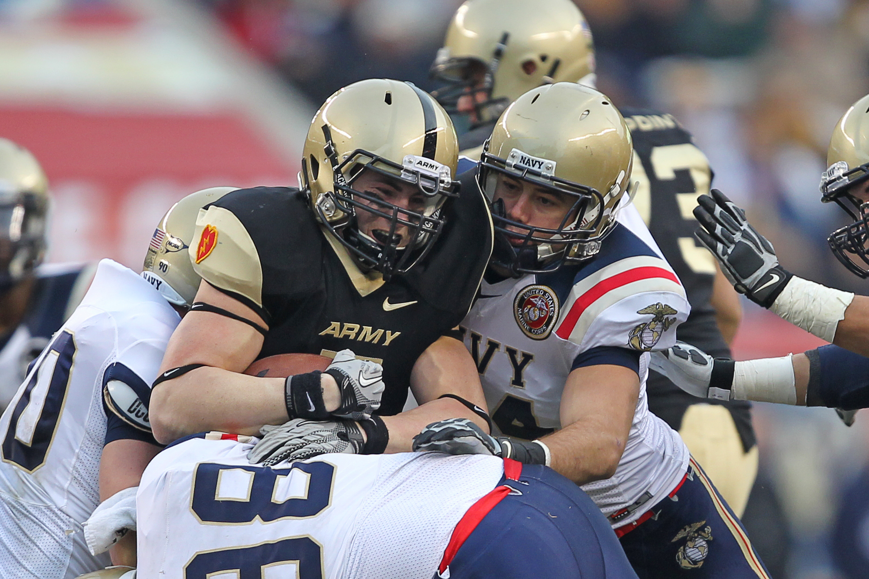 PHILADELPHIA - DECEMBER 11: Quarterback Trent Steelman #8 of the Army Black Knights is tackled during the game against the Navy Midshipmen on December 11, 2010 at Lincoln Financial Field in Philadelphia, Pennsylvania. (Photo by Hunter Martin/Getty Images)