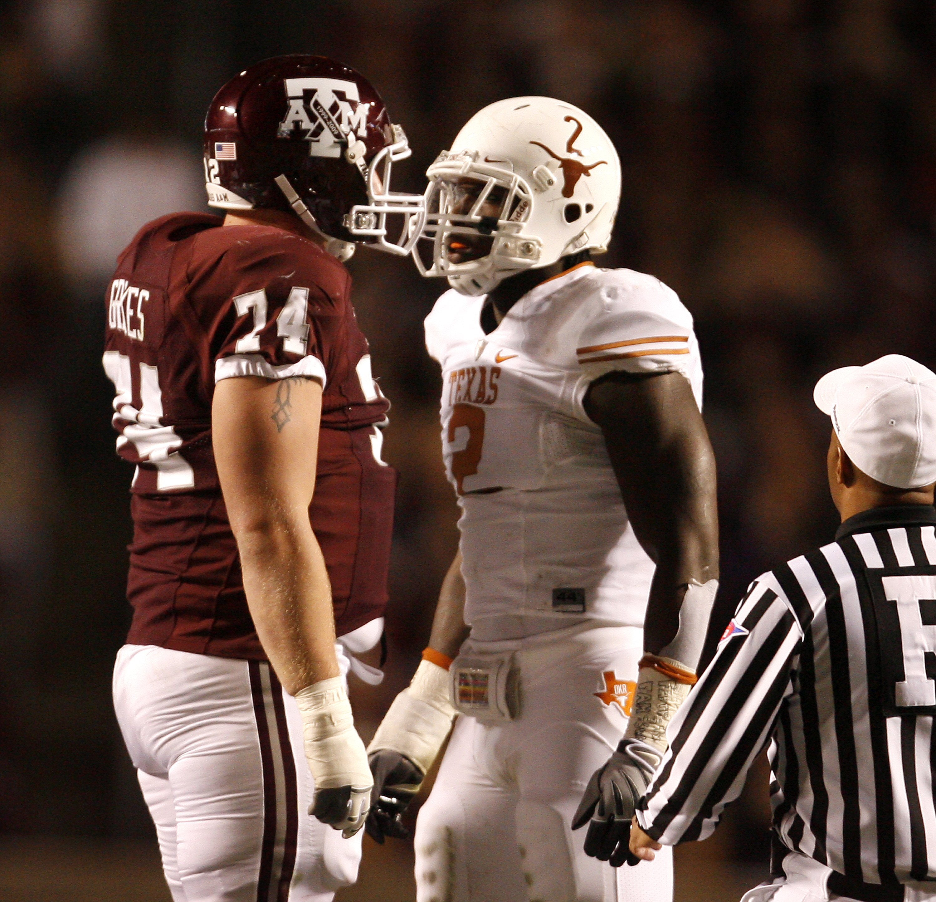 COLLEGE STATION, TX - NOVEMBER 26:  Right tackle Lee Grimes #74 of the Texas A&M Aggies confronts defensive end Sergio Kindle #2 of the Texas Longhorns in the first half at Kyle Field on November 26, 2009 in College Station, Texas. The Longhorns defeated