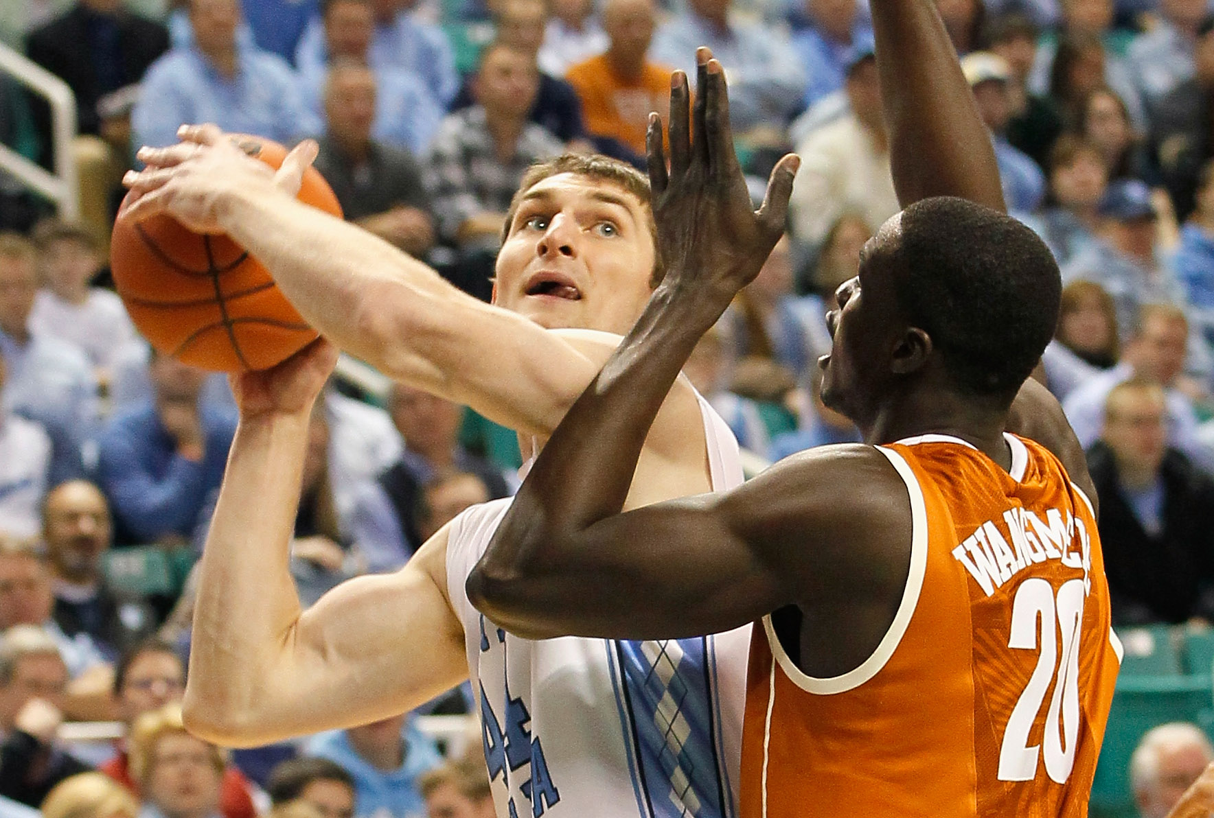 GREENSBORO, NC - DECEMBER 18:  Tyler Zeller #44 of the North Carolina Tar Heels attacks the basket against Alexis Wangmene #20 of the Texas Longhorns at Greensboro Coliseum on December 18, 2010 in Greensboro, North Carolina.  (Photo by Kevin C. Cox/Getty