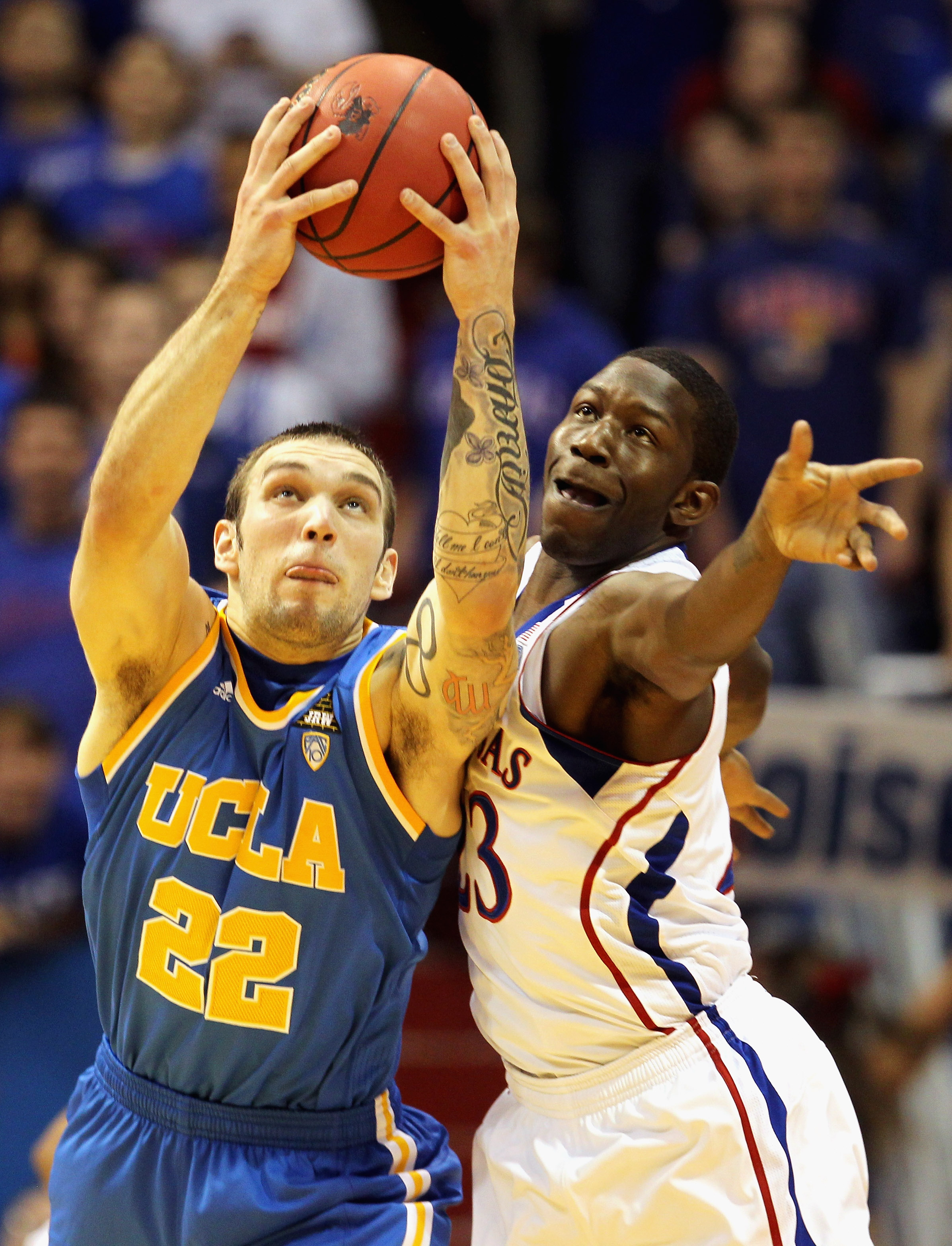 LAWRENCE, KS - DECEMBER 02:  Reeves Nelson #22 of the UCLA Bruins and Mario Little #23 of the Kansas Jayhawks battle for a loose ball during the game on December 2, 2010 at Allen Fieldhouse in Lawrence, Kansas.  (Photo by Jamie Squire/Getty Images)