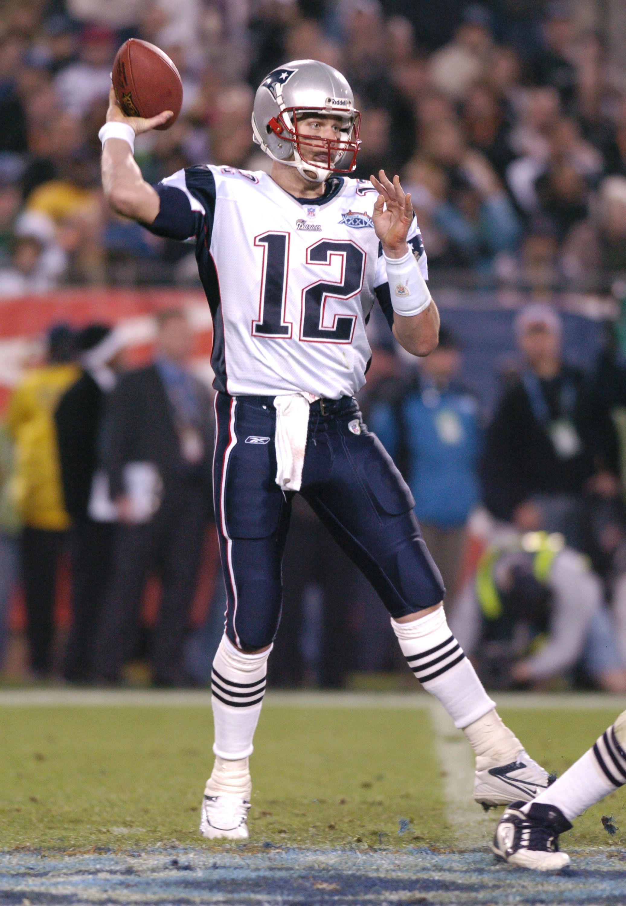 New England Patriots QB Tom Brady #12 with the ball during Super Bowl XXXIX between the Philadelphia Eagles and the New England Patriots at Alltel Stadium in Jacksonville, Florida on February 6, 2005.  (Photo by Al Messerschmidt/Getty Images)